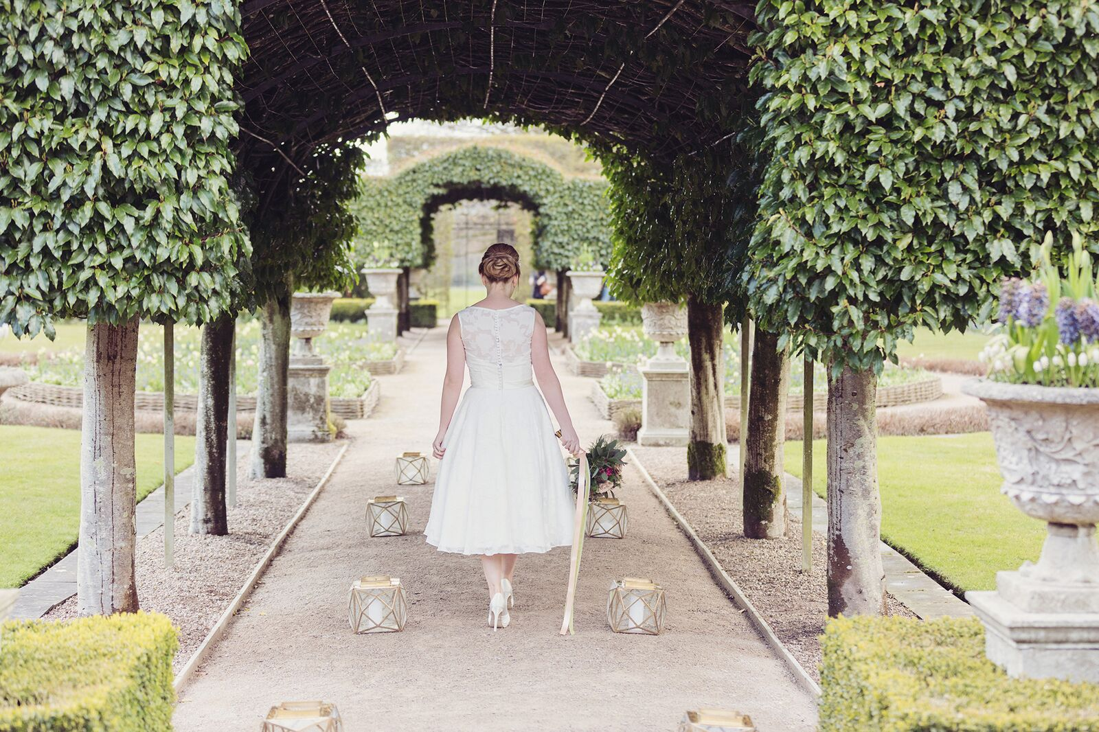 Holker bride in garden 2.jpg