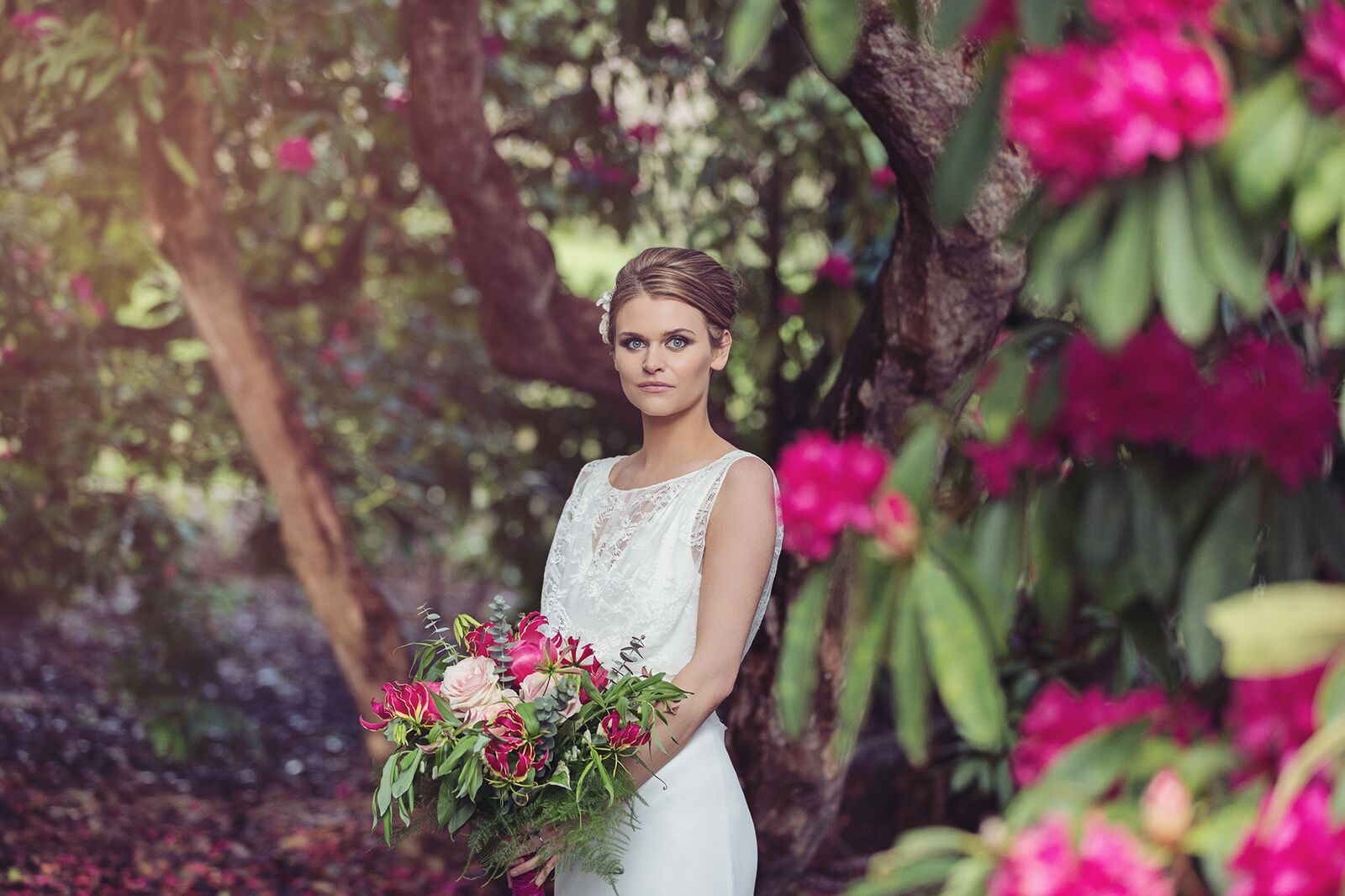 Holker bride in garden 3.jpg