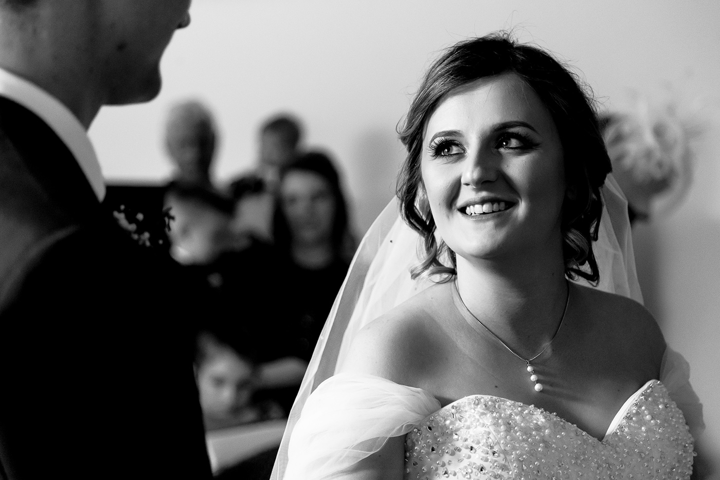 Lily smiles at Carl during the wedding ceremony at Chesfield Downs Golf Club.