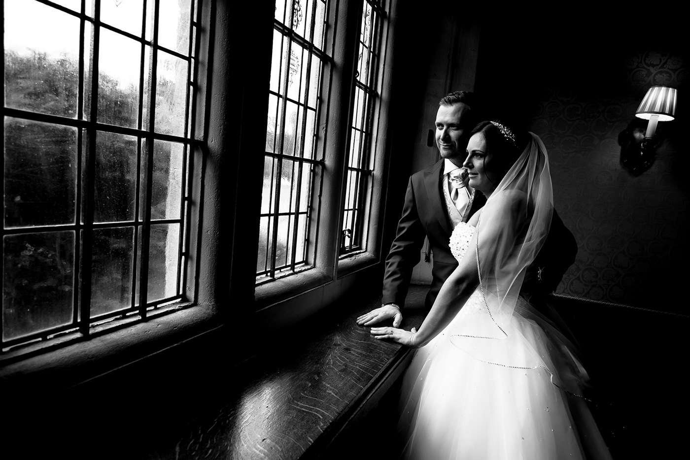 Andy and Donna pose by a window at Hanbury Manor Hotel.