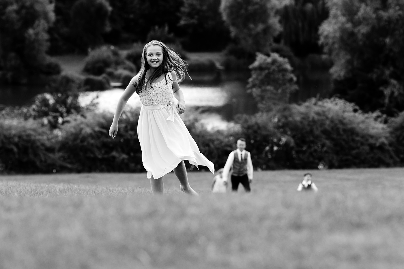 Children play on the hill at the Three Lakes Resort in Hertfordshire.