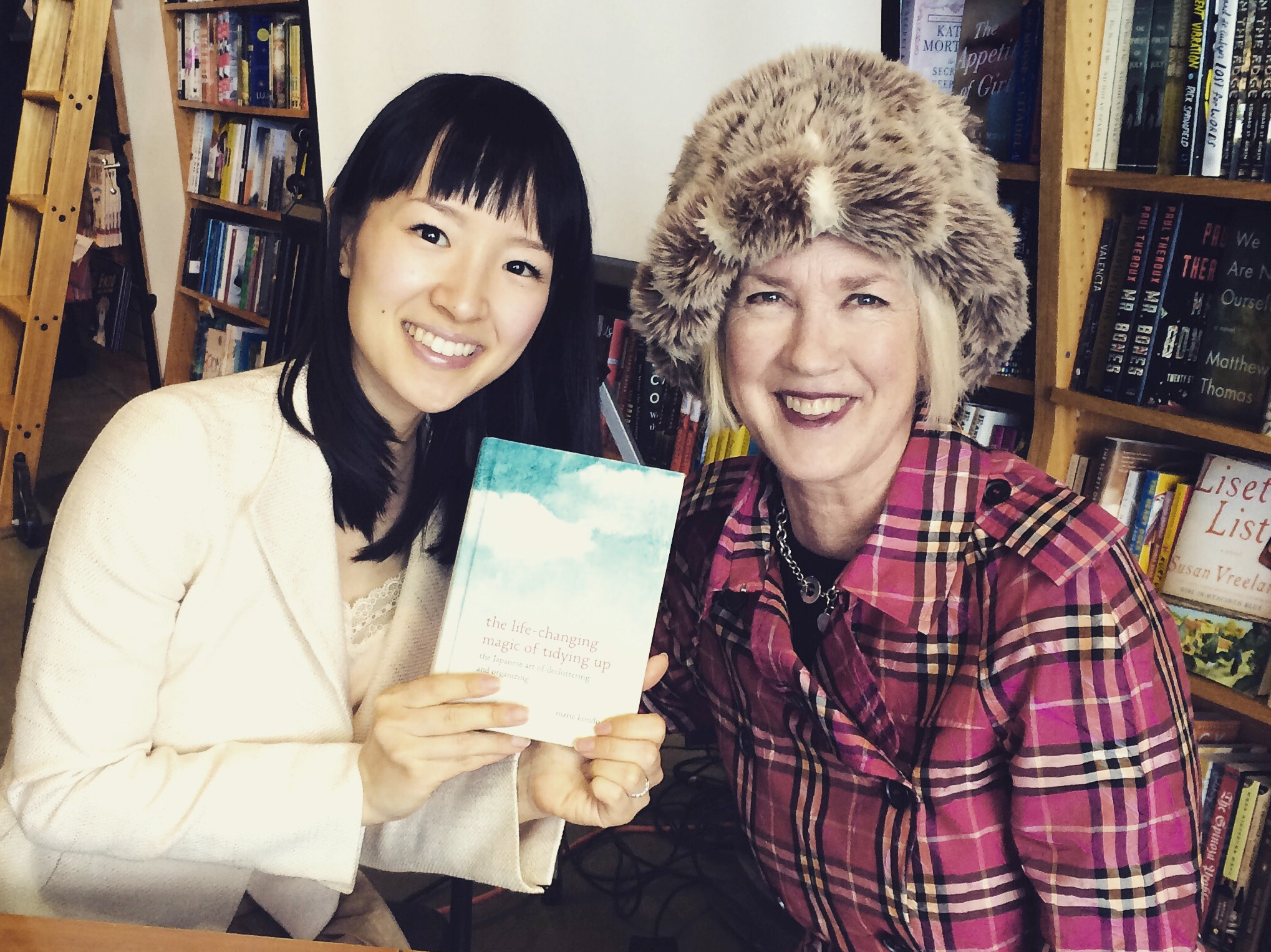 Marie Kondo (left) and Jane Dolan (right), with Marie Kondo's bestelling book   The Life-Changing Magic of Tidying Up