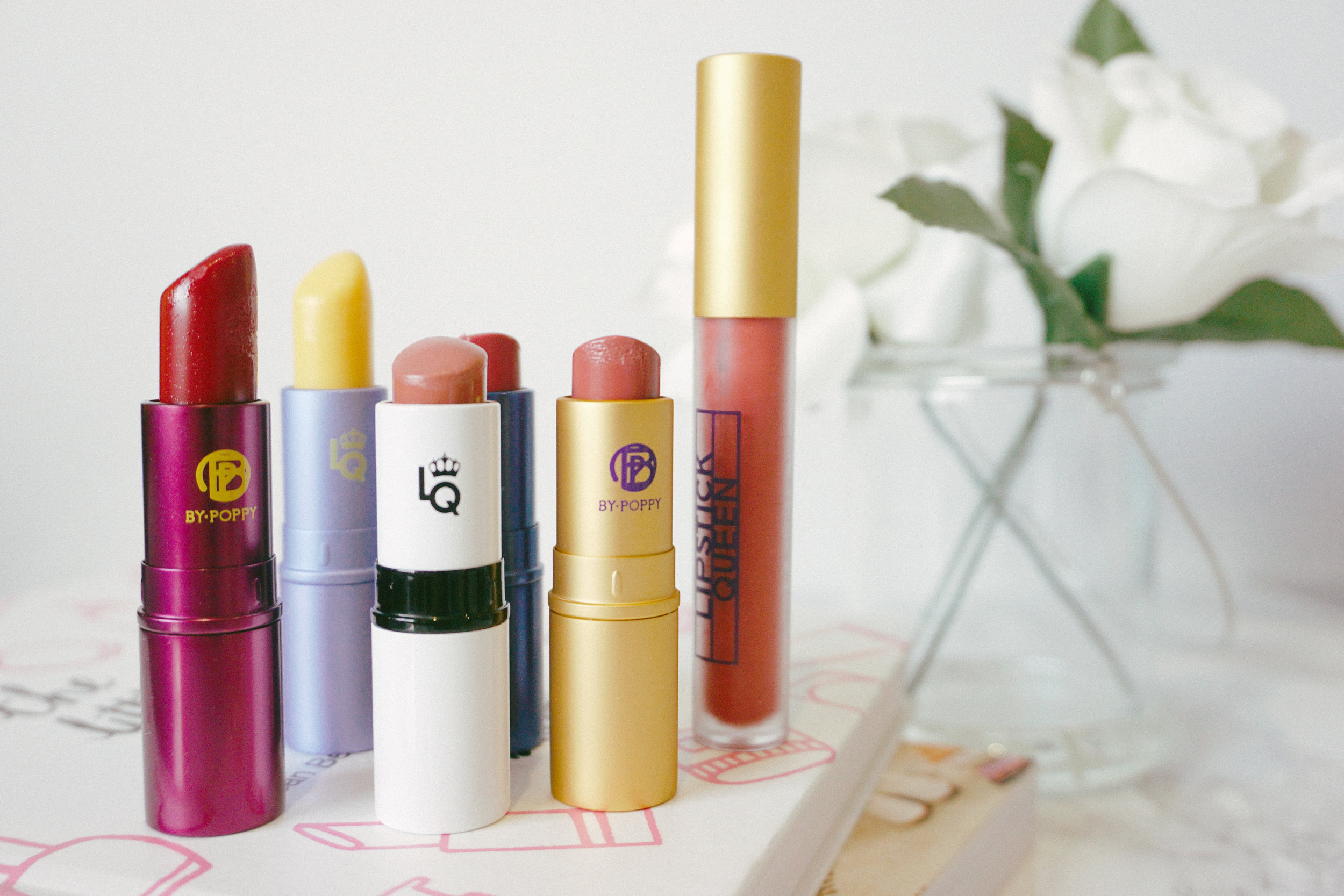 From left to right: Medieval, Mornin' Sunshine, Lipstick Chess in Pawn, Jean Queen, Saint Sheer Lipstick in Saint Nude, and Saint & Sinner Lip Tint in Rose