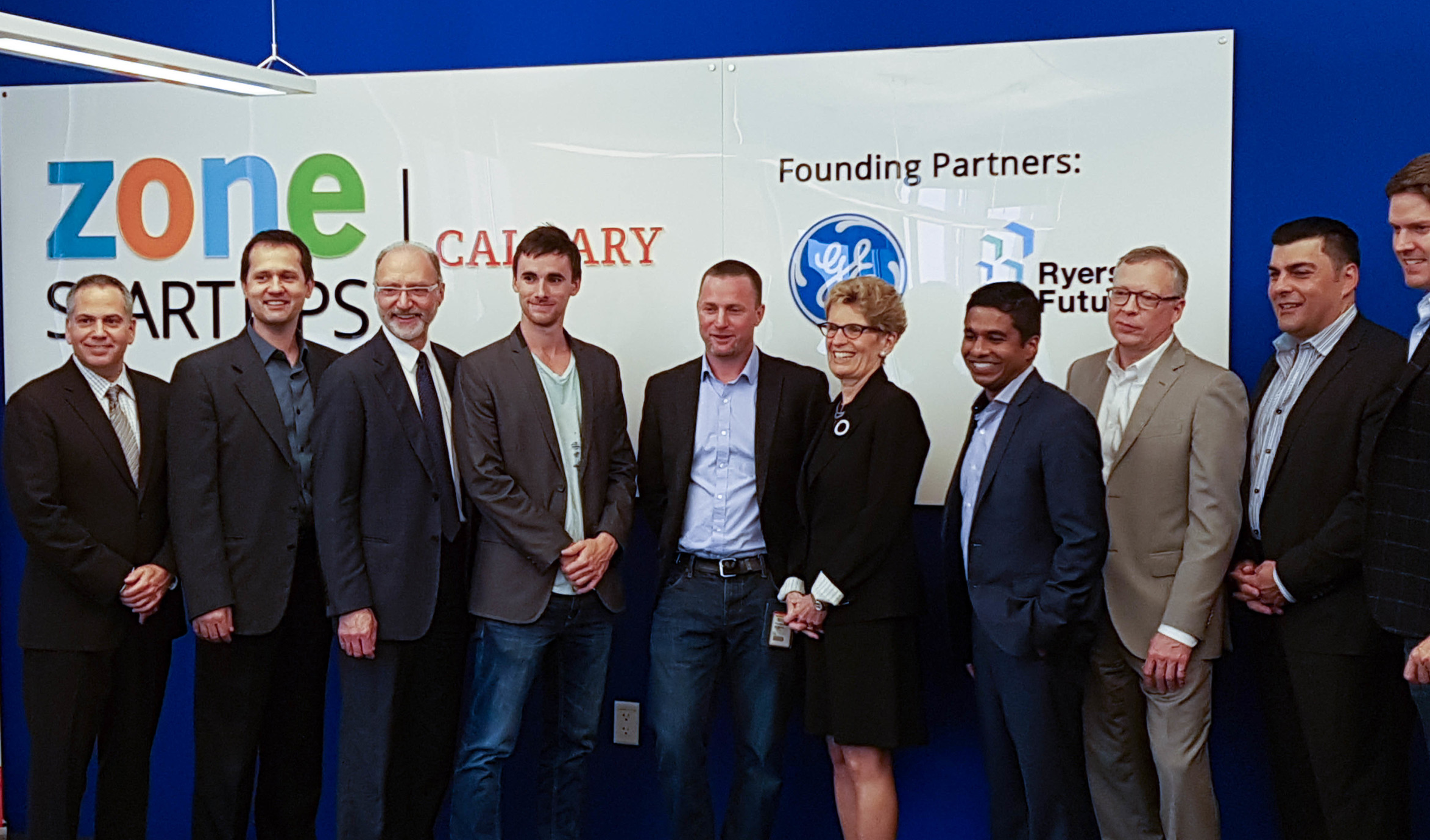 From the left, Stream System's  Bruno Rizzuto, Dumitru Cernelev and Allan Chegus with Ontario Premier Kathleen Wynne (centre), and GE CIO Gandeephan Ganeshalingam (right of Wynne).
