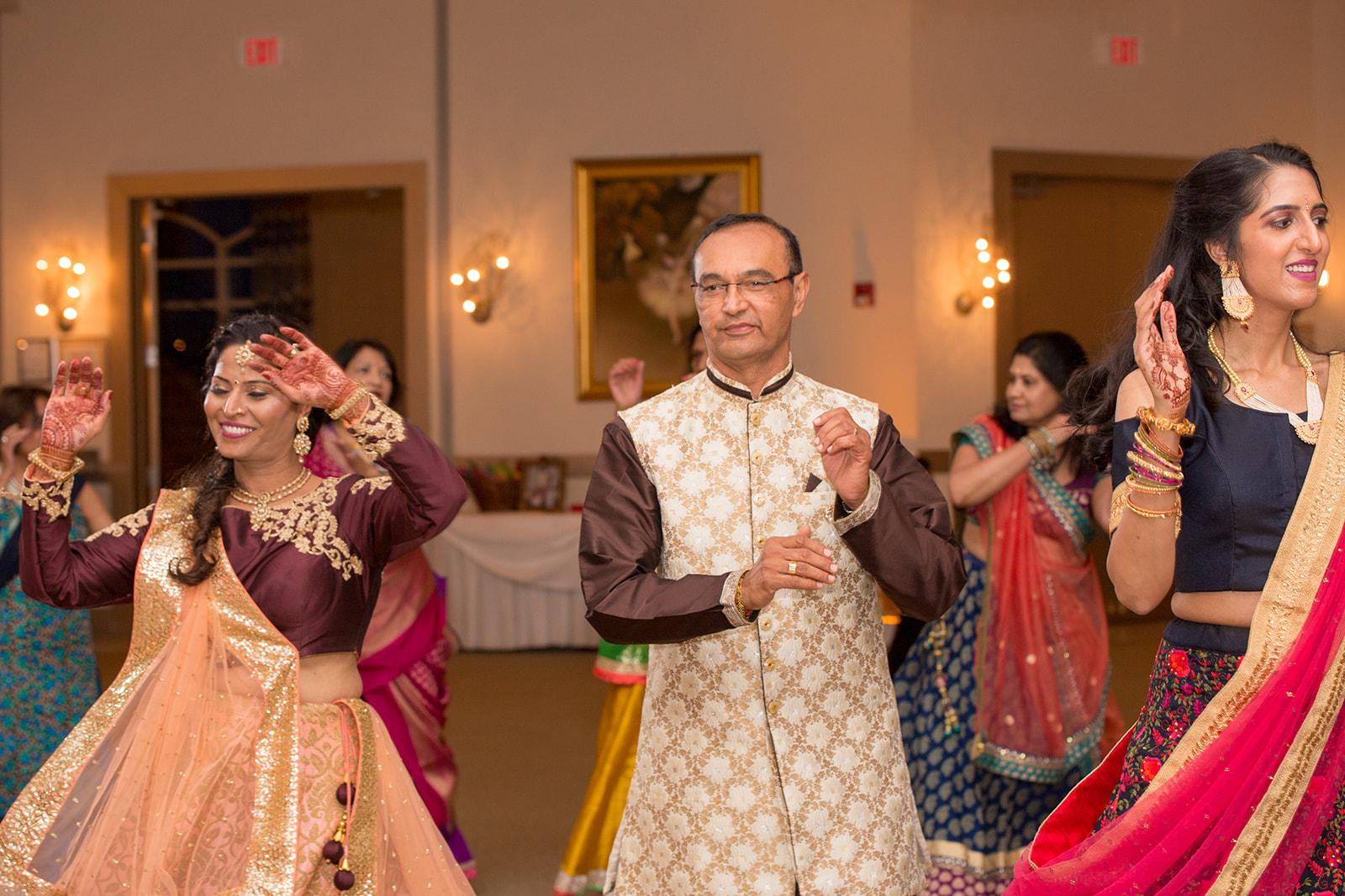 Le Cape Weddings - Puja and Kheelan - Garba A   -196.jpg