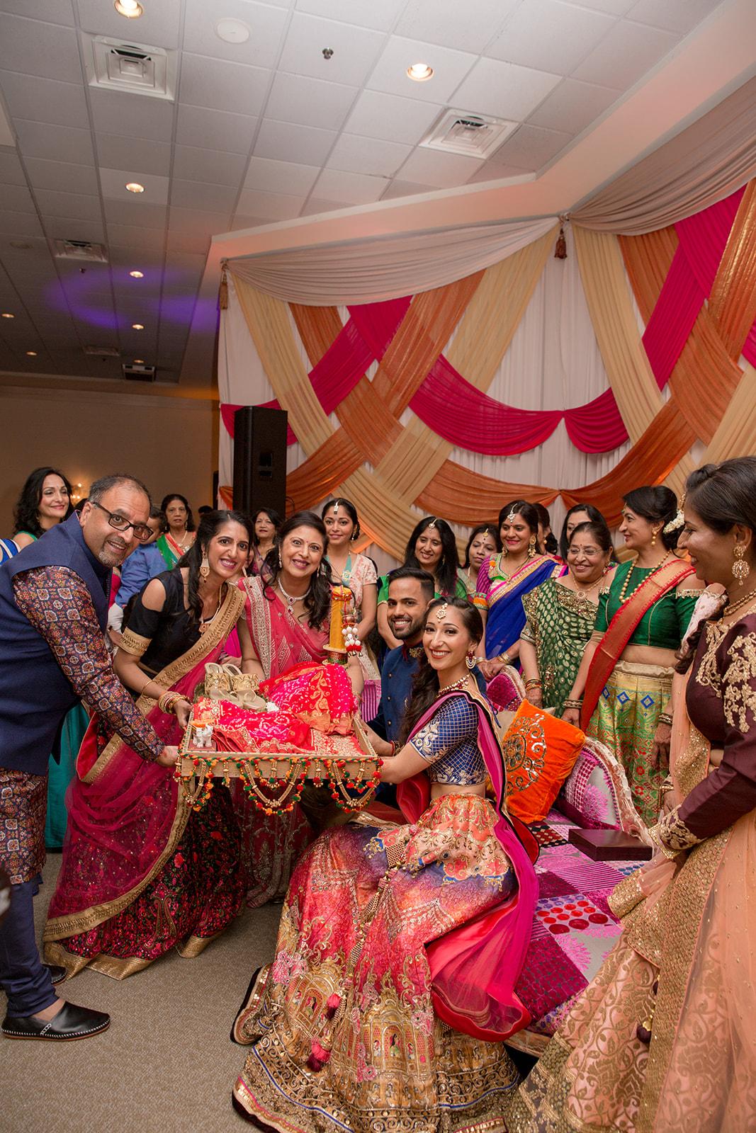Le Cape Weddings - Puja and Kheelan - Garba A   -125.jpg