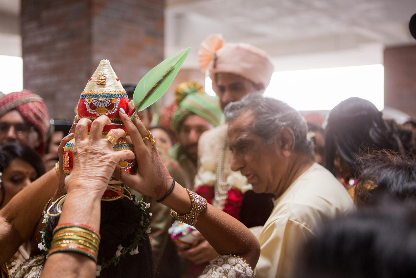 Le Cape Weddings - Puja and Kheelan - Baraat -41.jpg