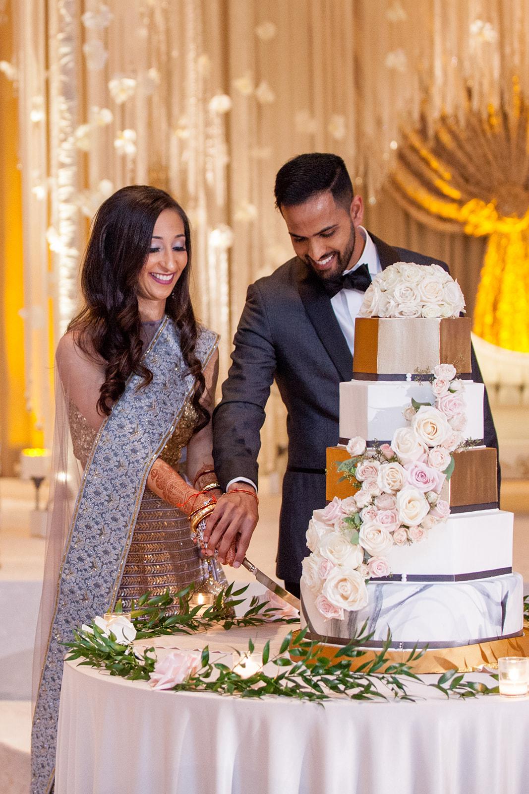 Le Cape Weddings - Puja and Kheelan - Reception -20.jpg