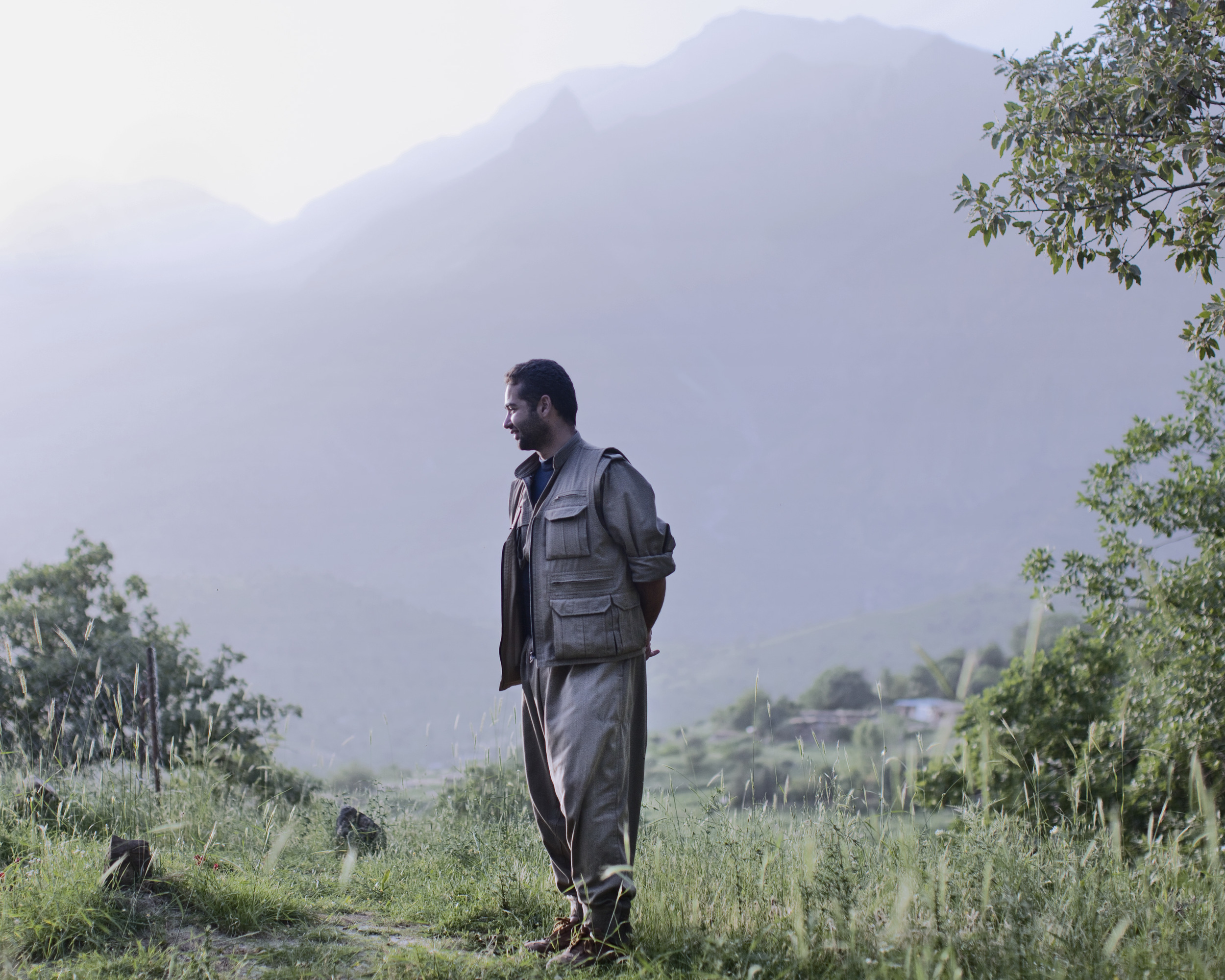 Hans, a guerrilla fighter with the Kurdish Independece fighting force known as PJAK, at his outpost in the Khandil Mountain Range.