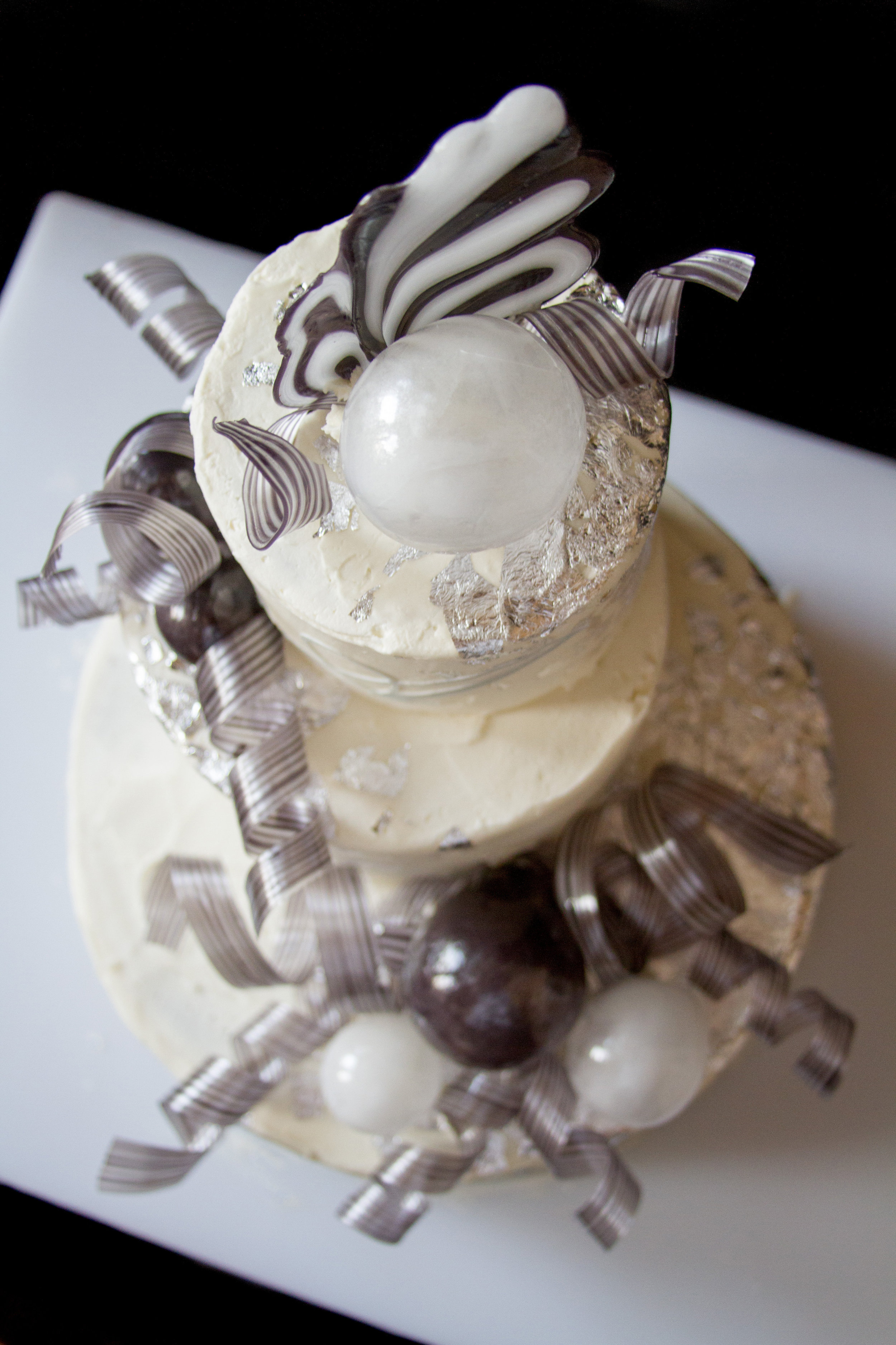 Silver Leaf, Blown Sugar orbs, and Pulled Sugar Ribbons on a cake. Photo Courtesy of  Annah Hamby Photography