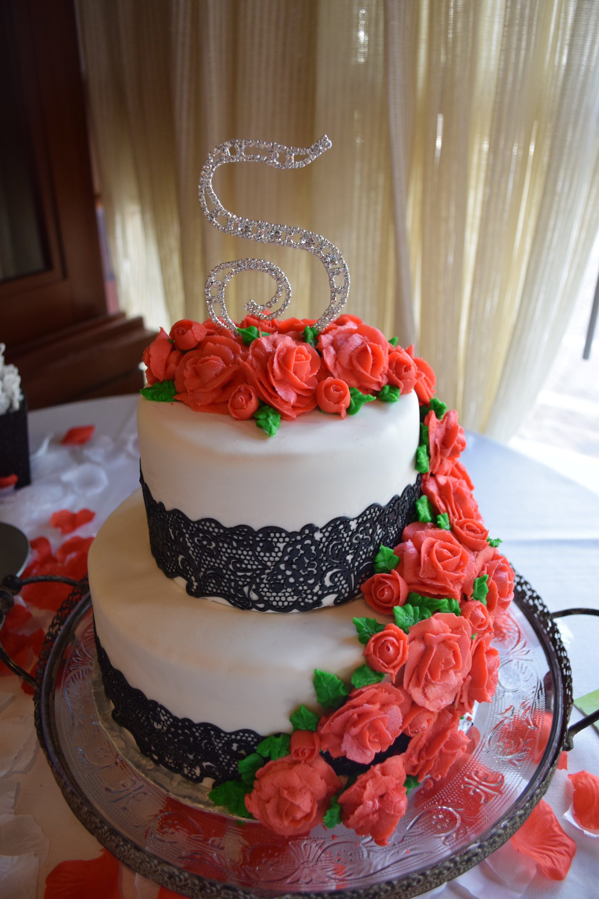 Buttercream Roses and Edible Lace on a White Fondant Background