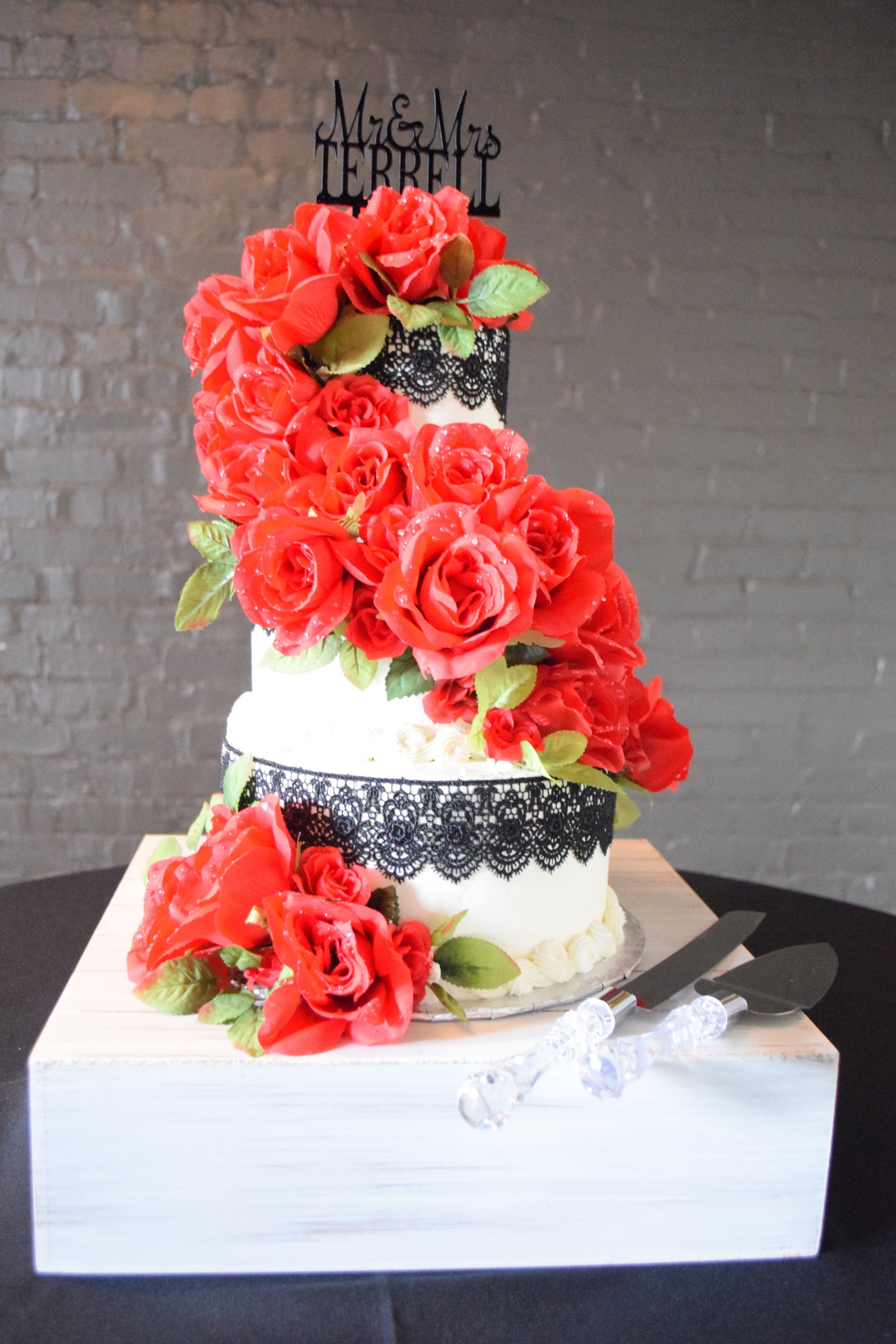 Silk Roses and Black Lace on Buttercream Off-Set Wedding Cake