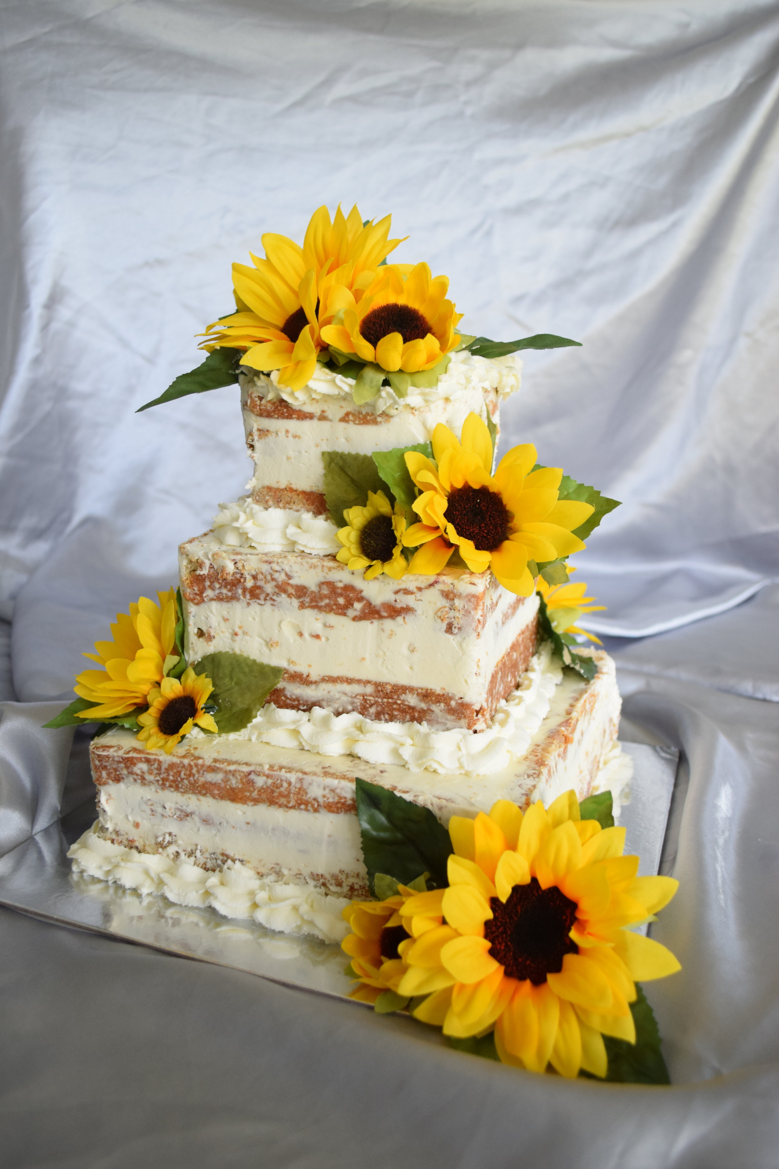 Strawberries and Cream Naked Wedding Cake with Whipped Cream Boarder and Sunflower Accents