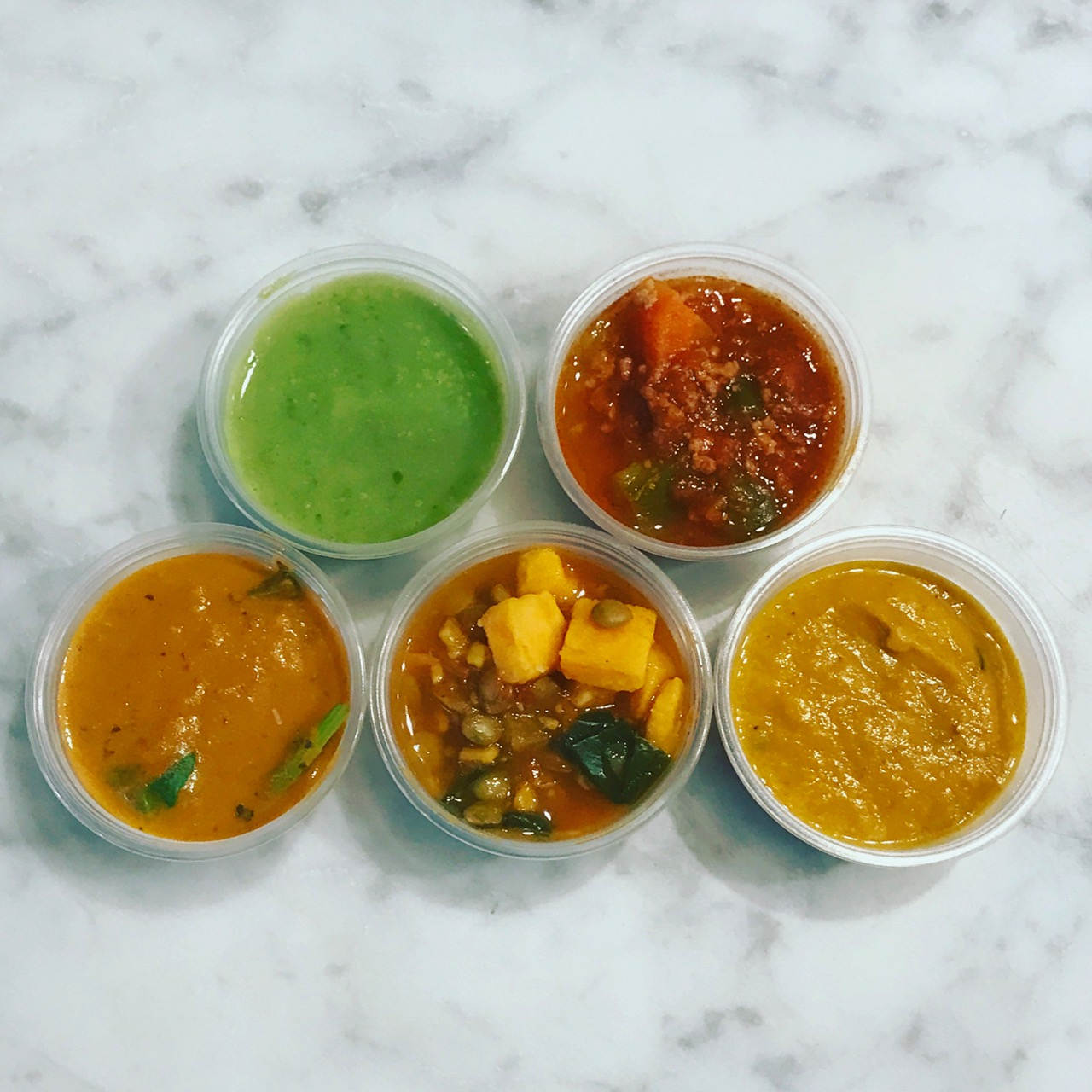 SOUPS   Soups rotate daily and change with the seasons. All of our stocks are made from scratch and are low in sodium. If we use dairy, it is non-GMO, locally sourced and grass-fed.   Pictured:  Green Goodness, Turkey Chili, Tomato Spinach, Sweet Potato & Collard Stew, Pumpkin Coconut
