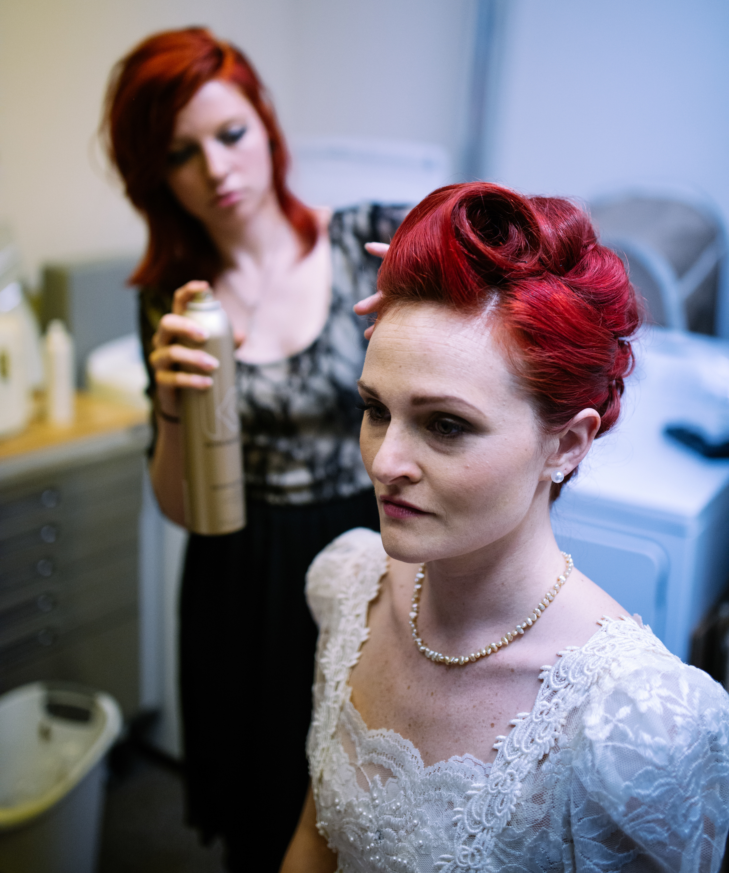 Erin Marshall gets her hair done in preparation for the fashion show at Bloomington Royale Hair Parlor, March 8th, 2014.