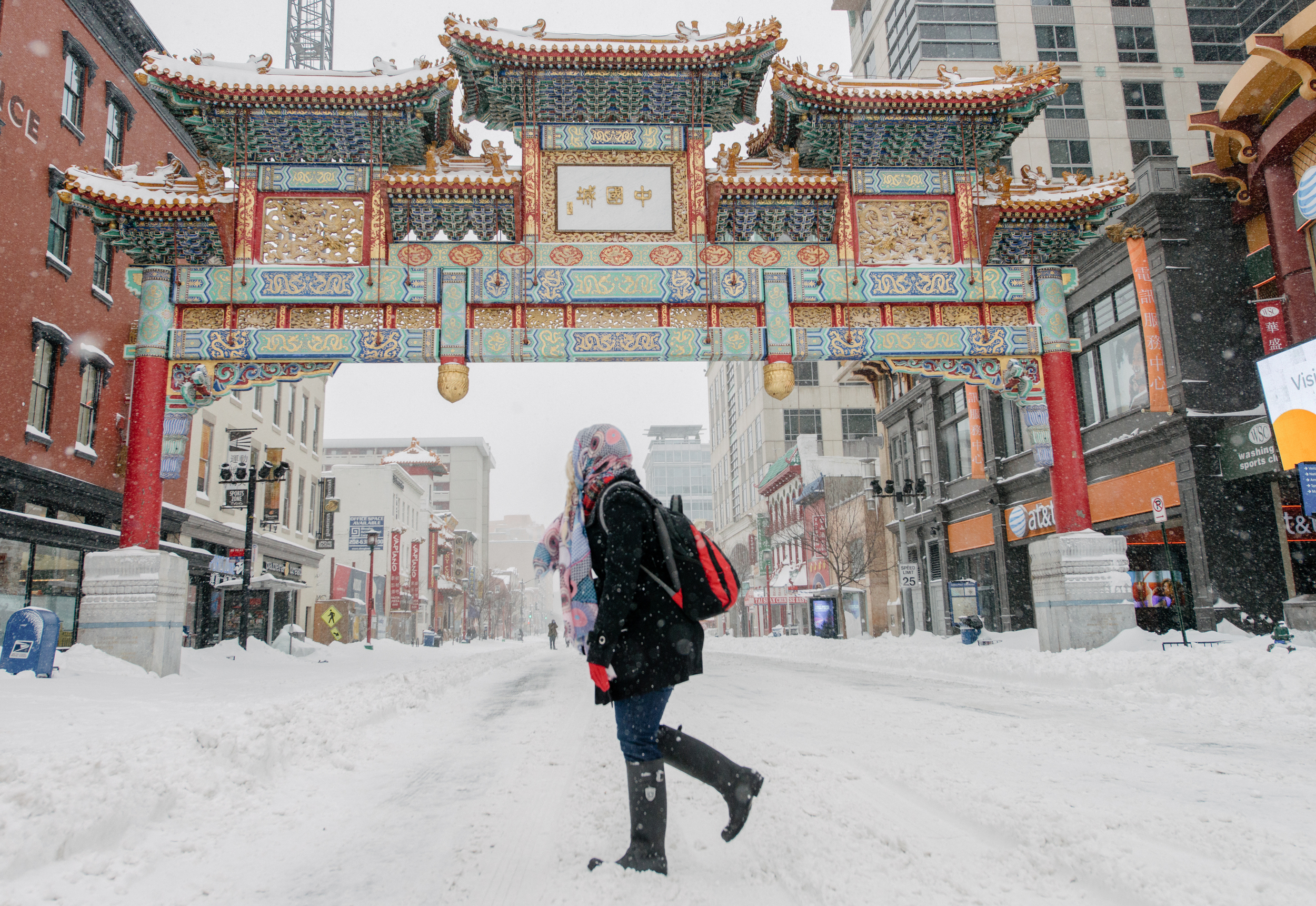A pedestrian walks in China Town in Washington, D.C. on January 23, 2016. Snow storm Blizzard inundates the Nation's Capitol.