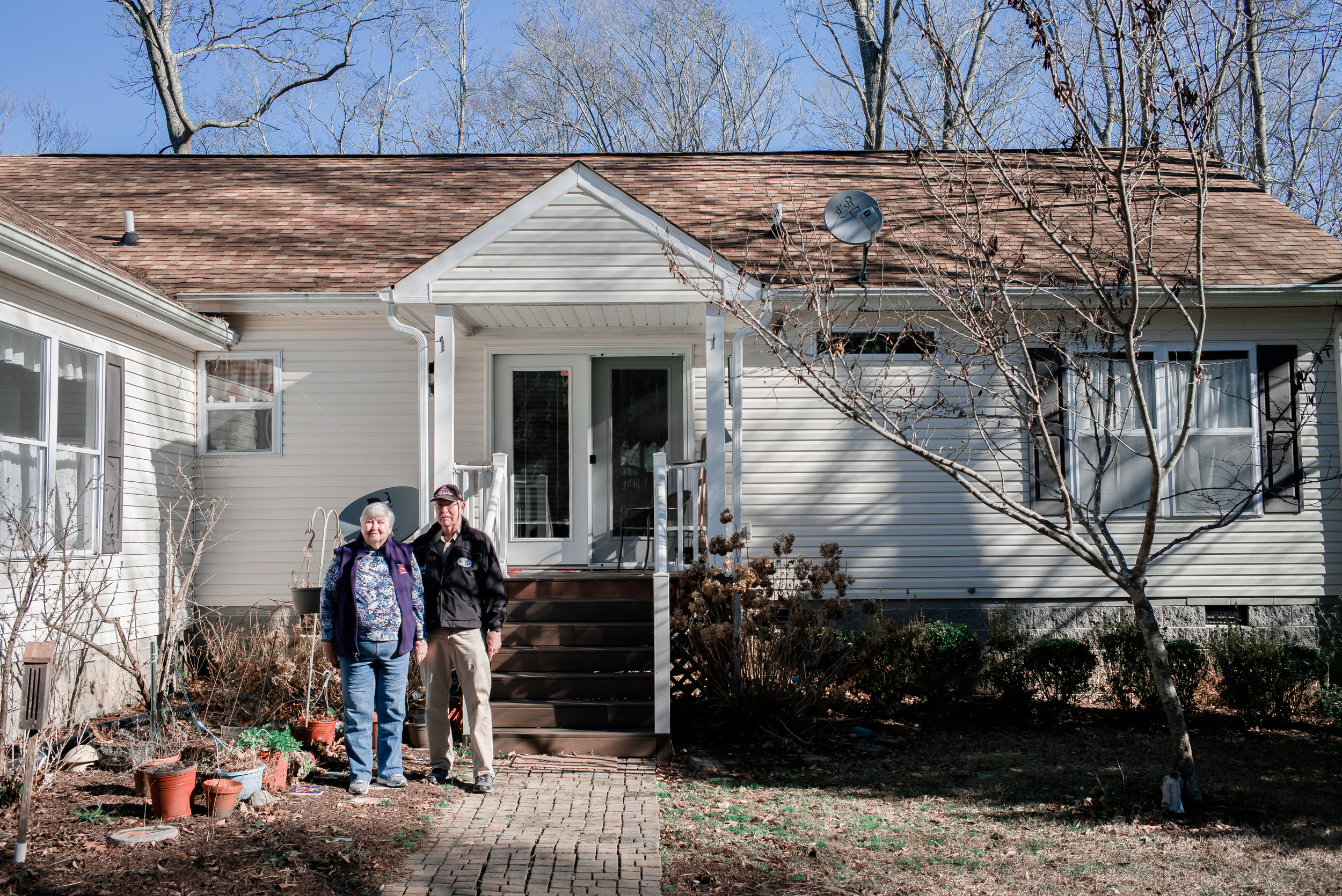(L to R) Josephine A. Field 78, and Thomas C. Field, 78, pose for a portrait in front of their Lake Gaston house on Monday, February, 6th, 2017 in Littleton, North Carolina. The couple's son asks them to move with him because of Tom's heath situation, therefore, the couple has to sell their house where they have lived over 10 years.