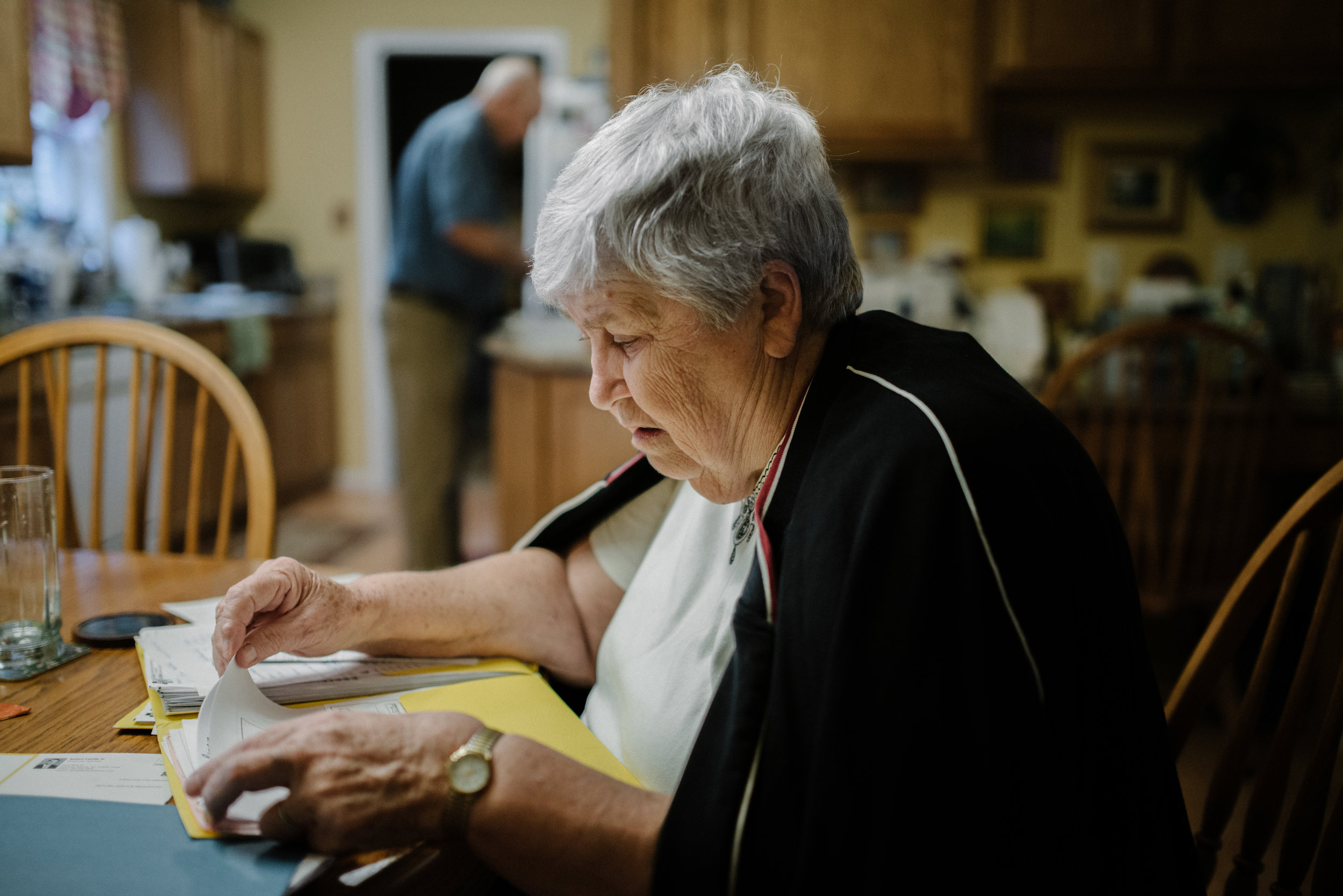 Josephine A. Field, 78, organizes Tom's insurance bills on Thursday, November 5th, 2015 in their Lake Gaston house in Littleton, North Carolina. Tom's insurance company covers most of costs including the usage of helicopter.