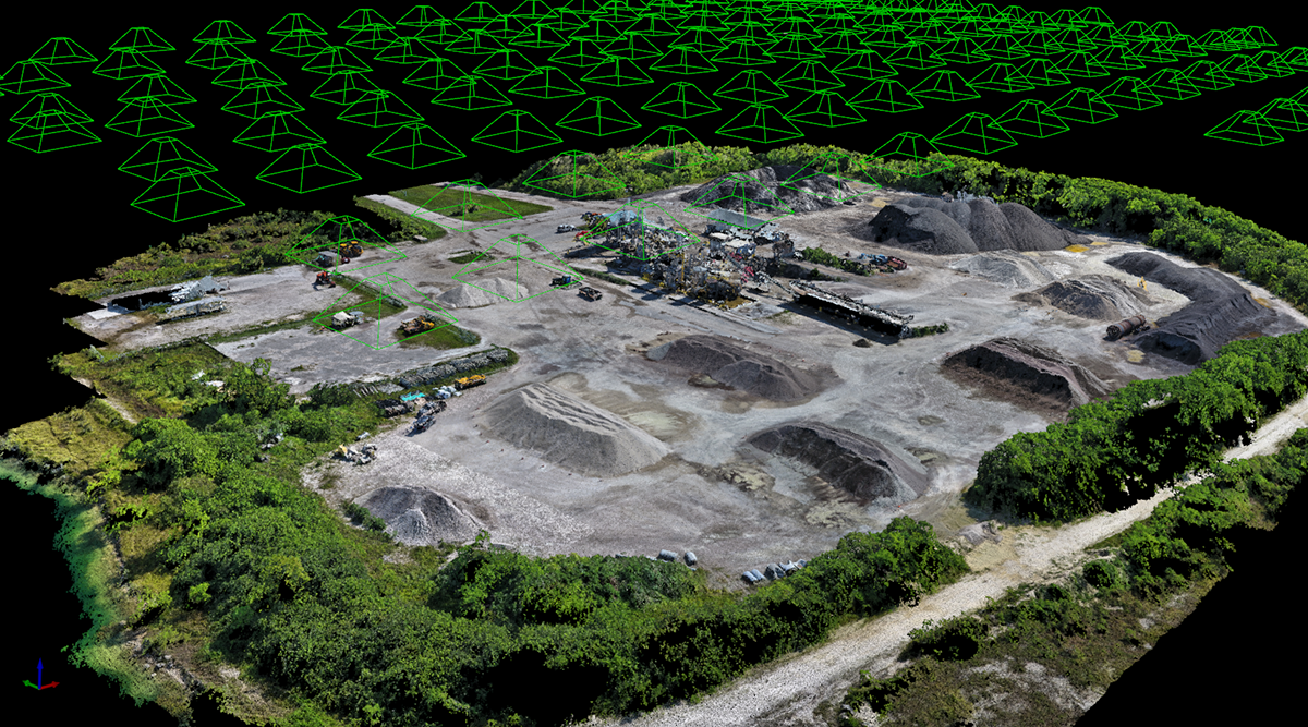 A point cloud created from photos collected by a drone with the camera positions noted by the green triangles. Image courtesy of URC Ventures