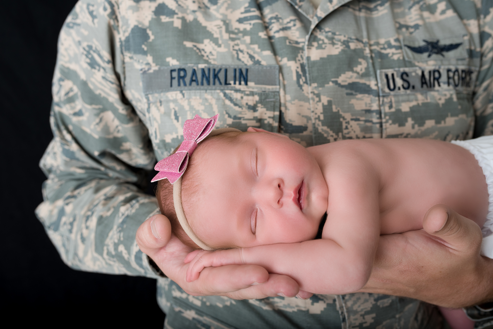 Military newborn in Daddy's arms