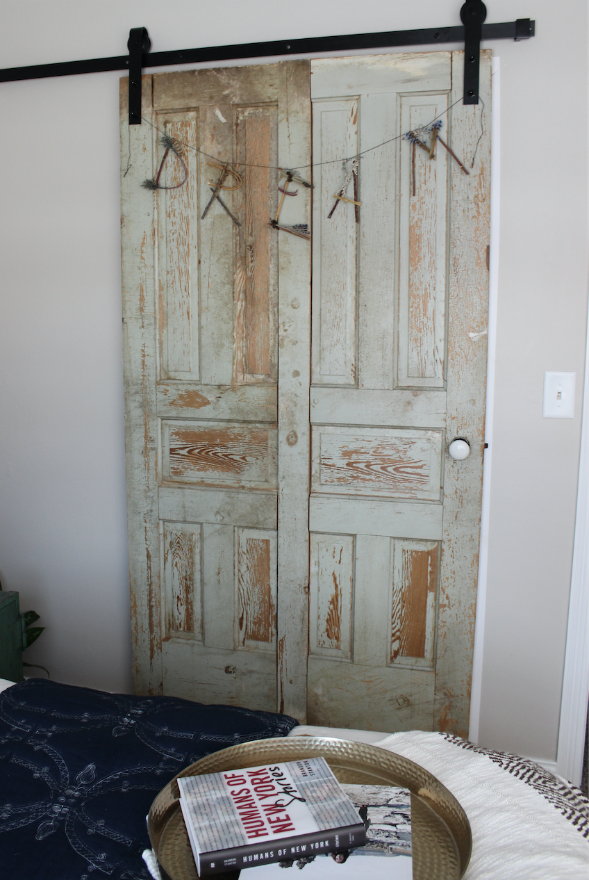 The sliding door is one of my favorite features. I love the boho feel the vintage door added (we found a pair of doors and made it into one piece) and the fact that it slides left us room to actually fit the bed!