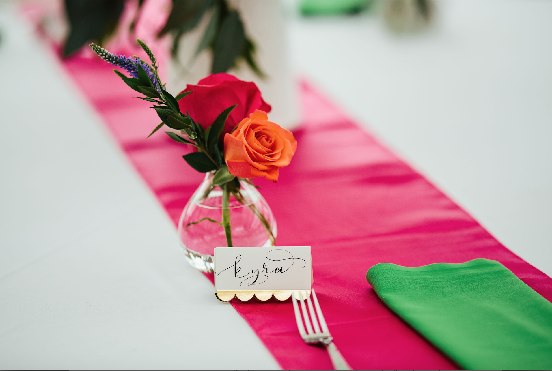 Place cards with bud vases