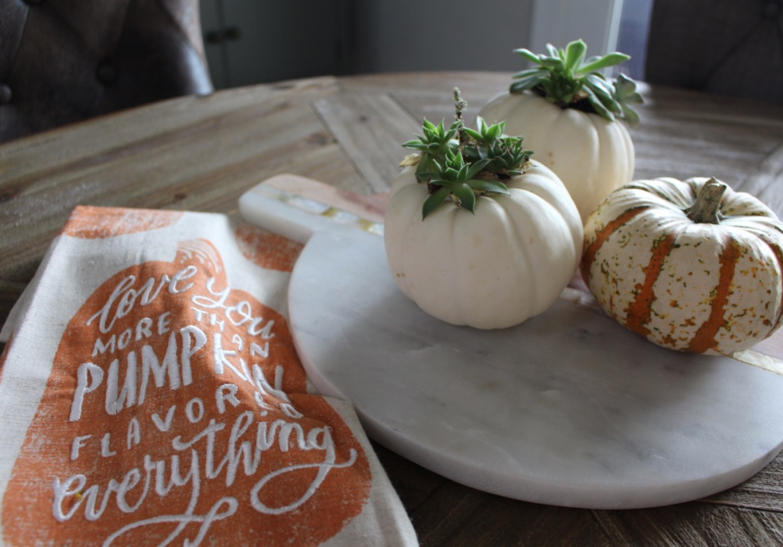 Mini pumpkins and succulents.