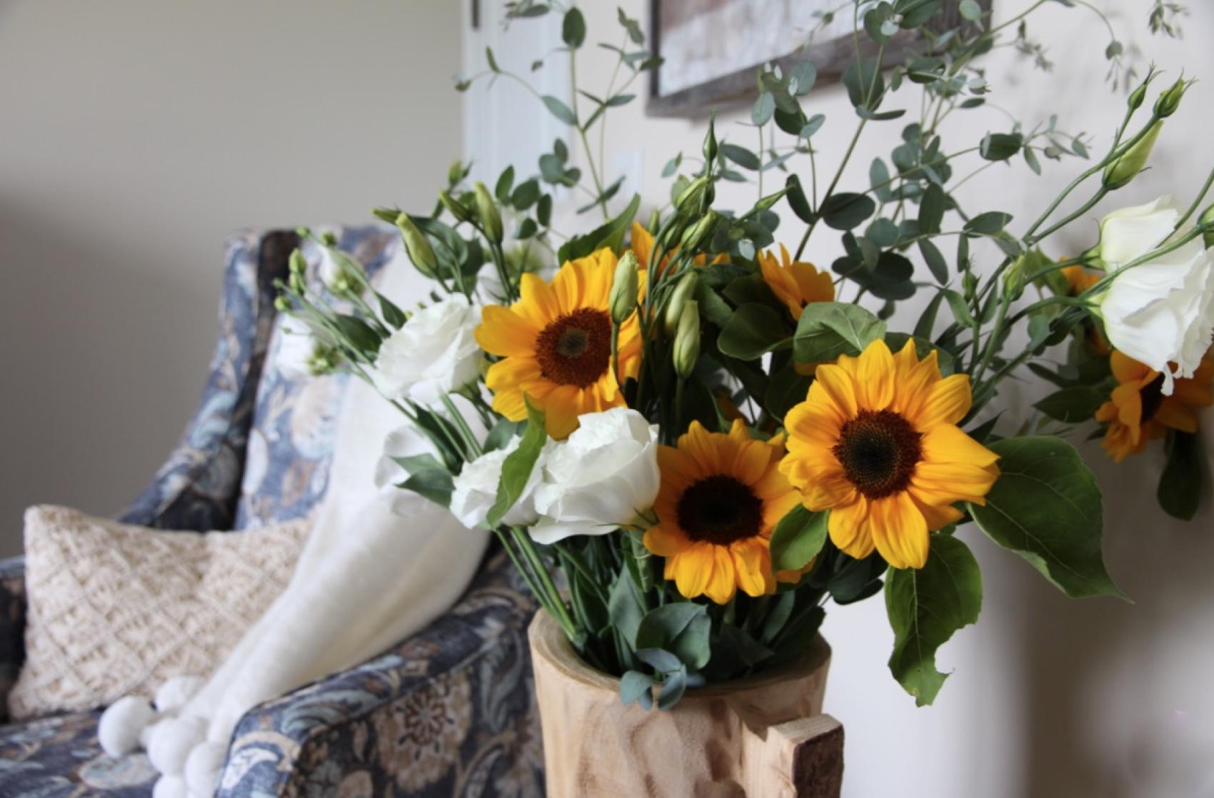 Sunflowers in wood vase