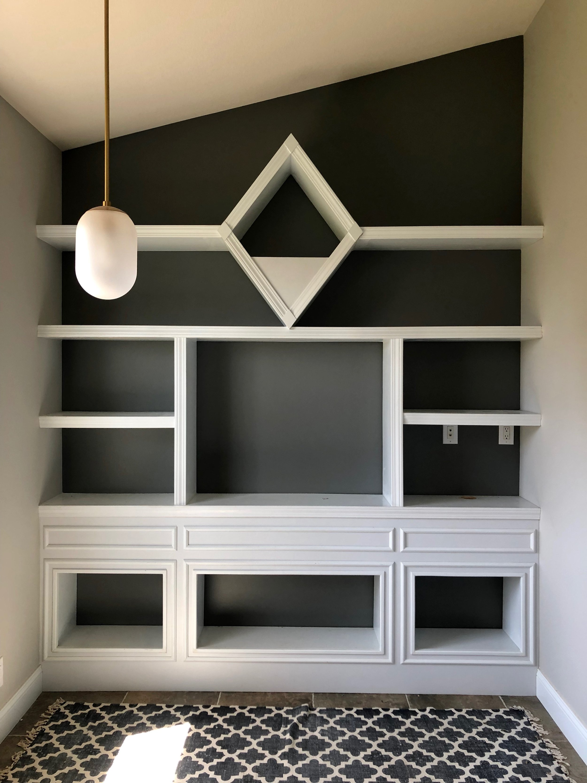Grey paint behind book shelves.