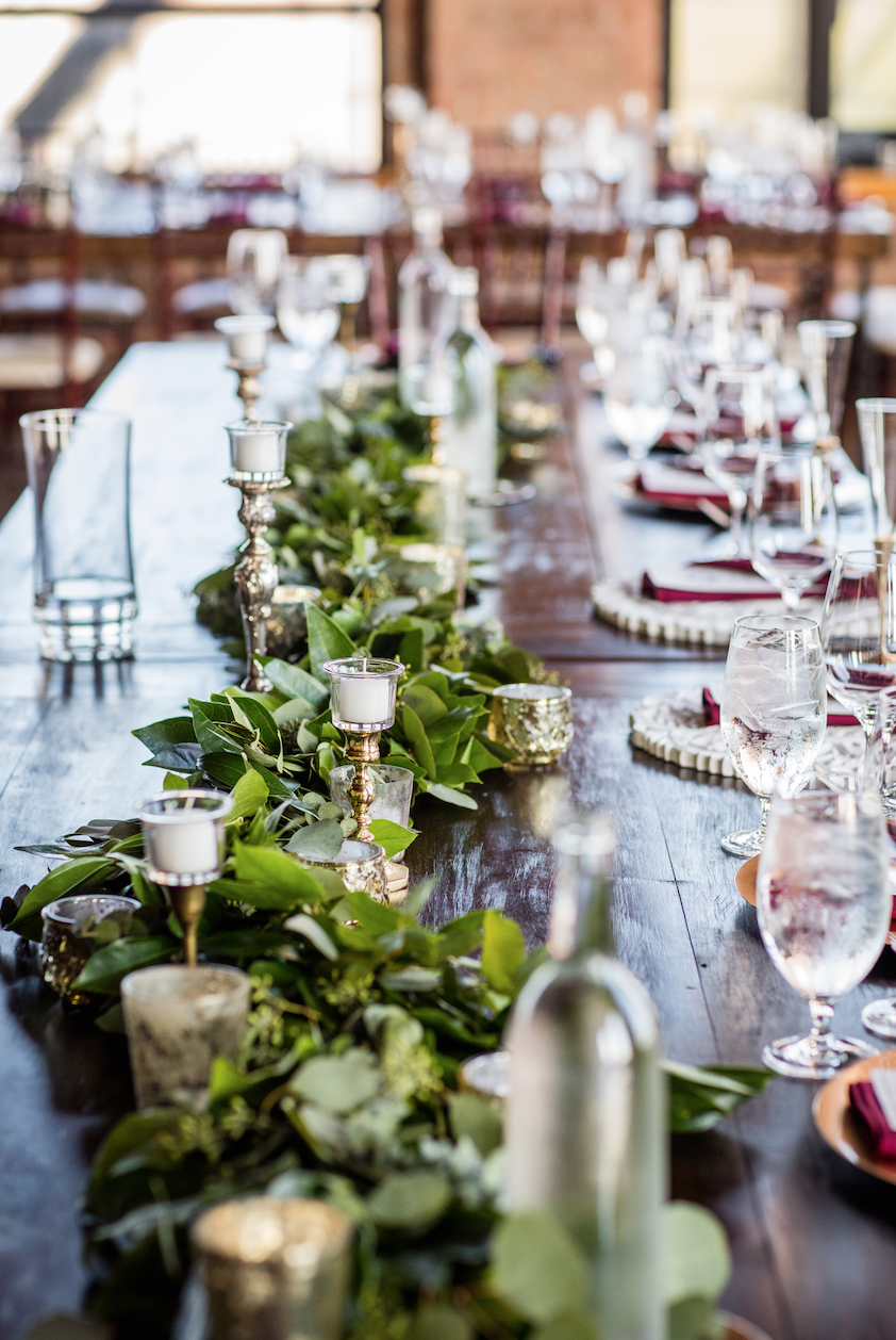 The greenery here makes the tablescape.