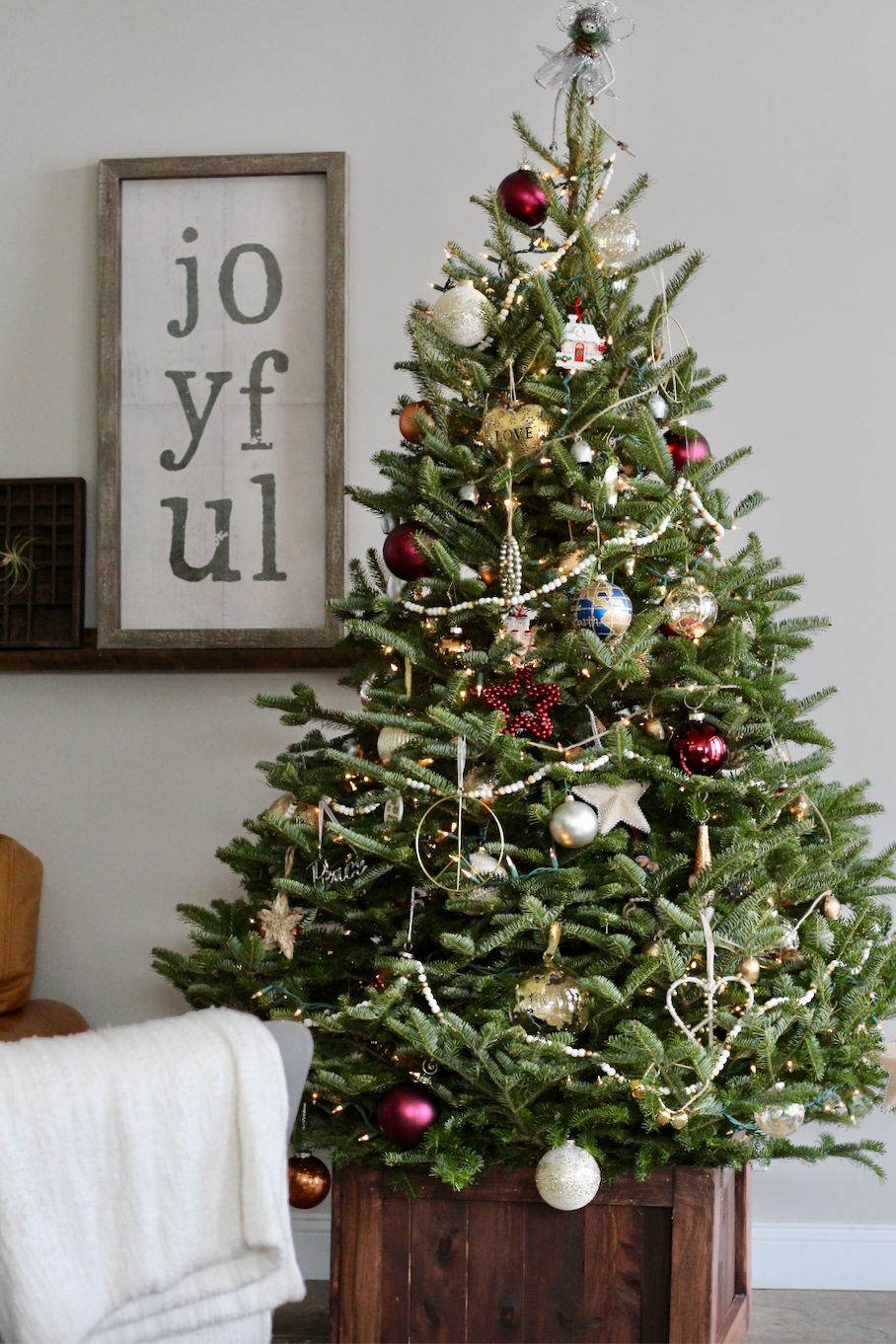 Fresh Christmas Tree in wood box.
