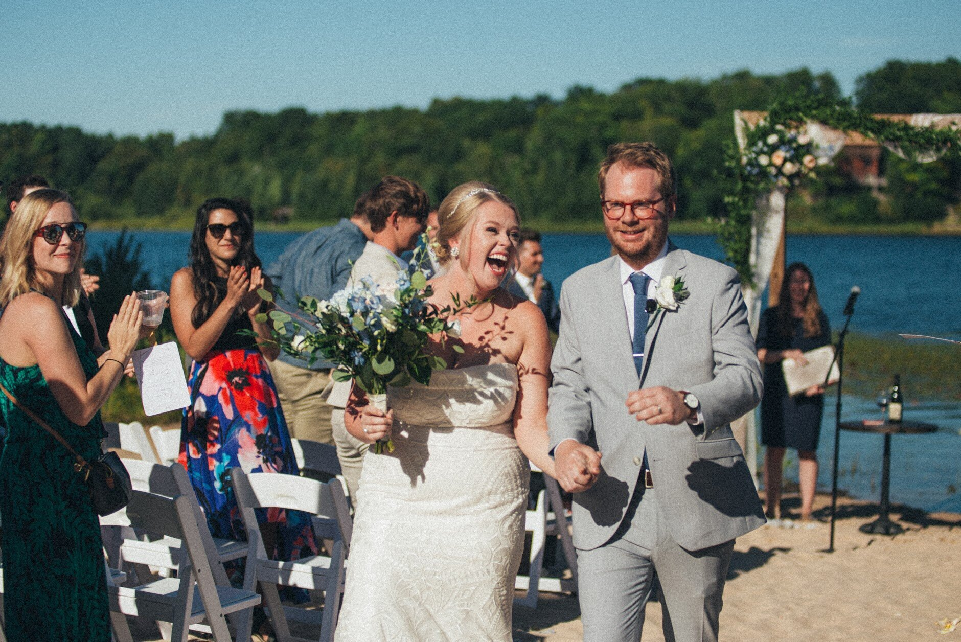 Beach side wedding. That is one happy Bride and Groom