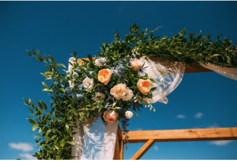 Wedding arch with floral swag