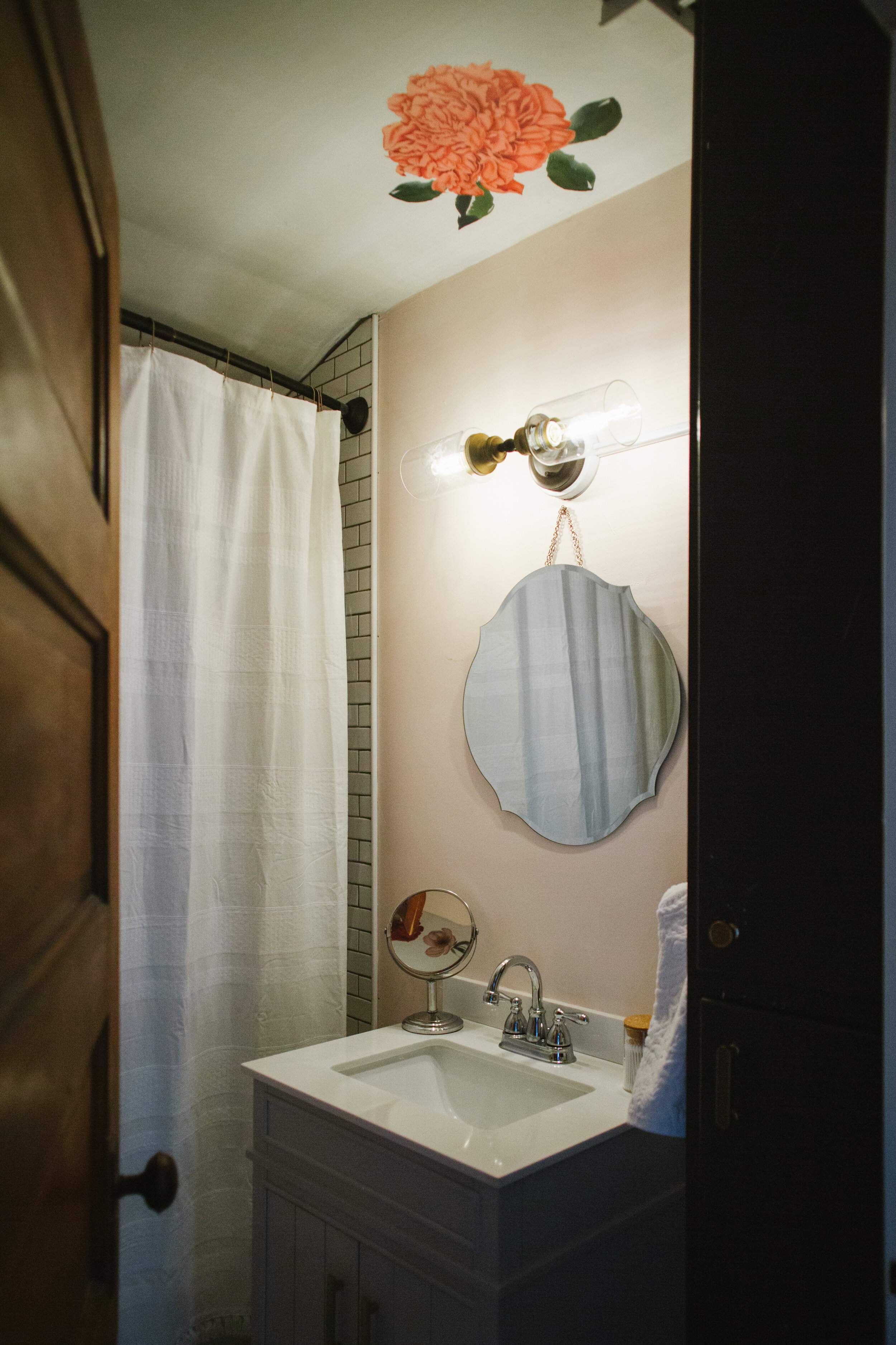 Bathroom with ceiling decal