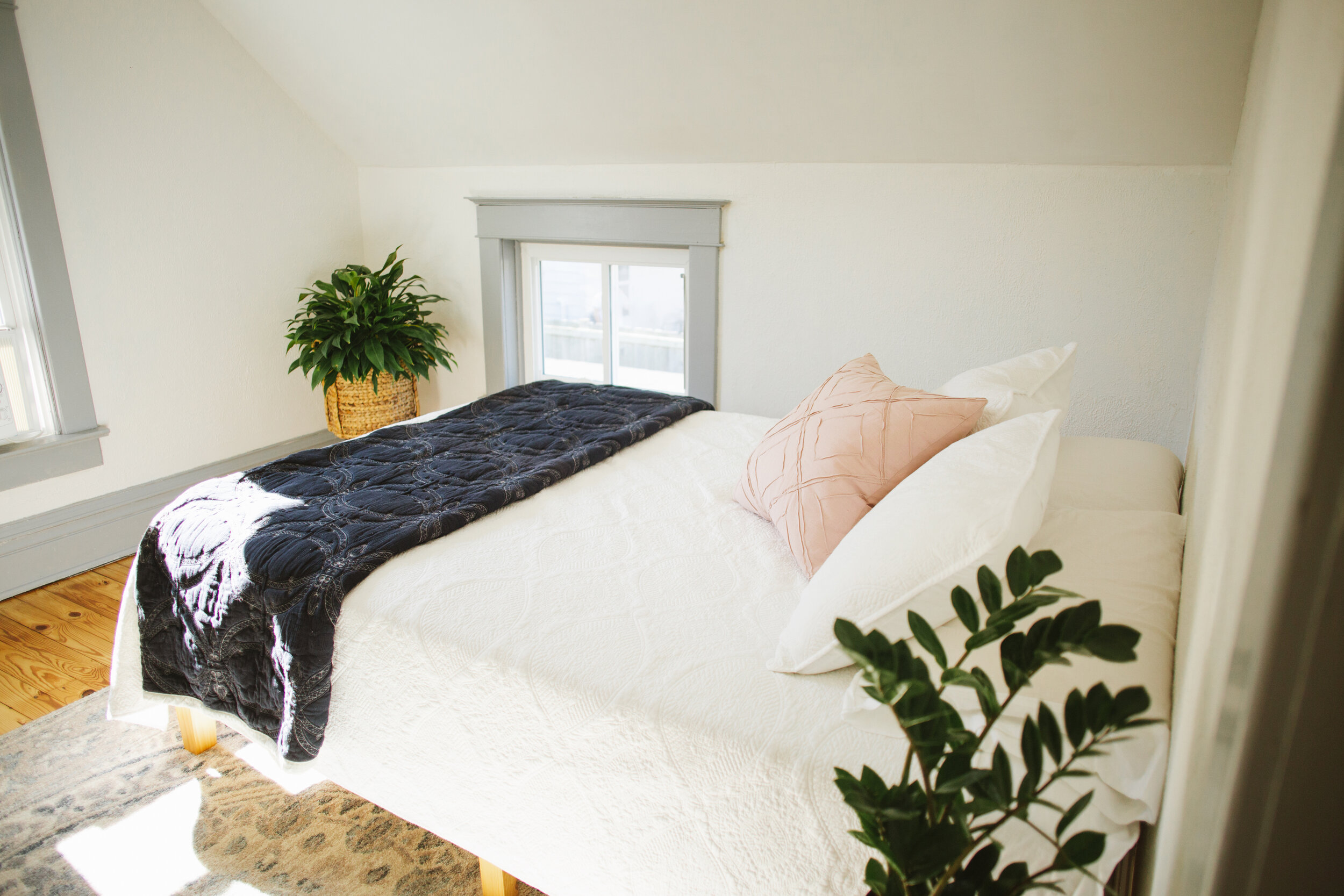 Using all white bedding in the Airbnb makes it easier to maintain.
