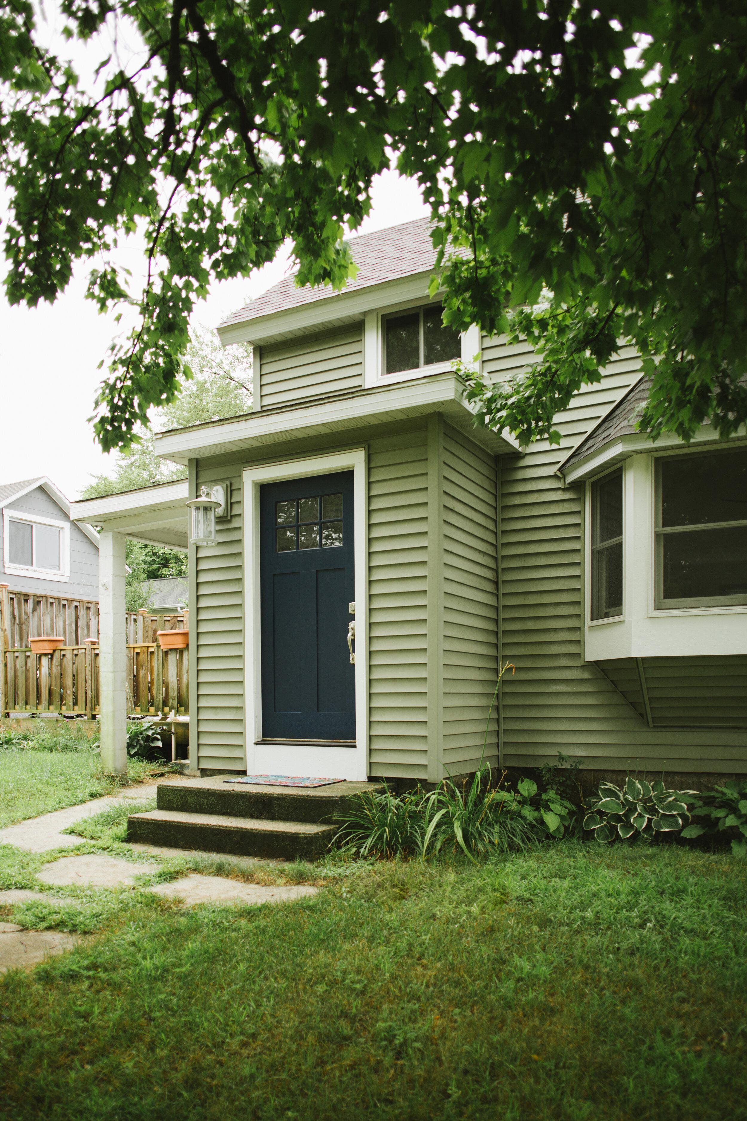 Green house with blue door