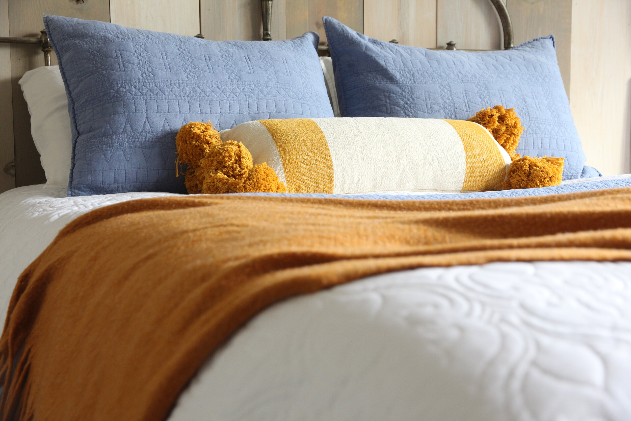 Mustard, blue and white bedding