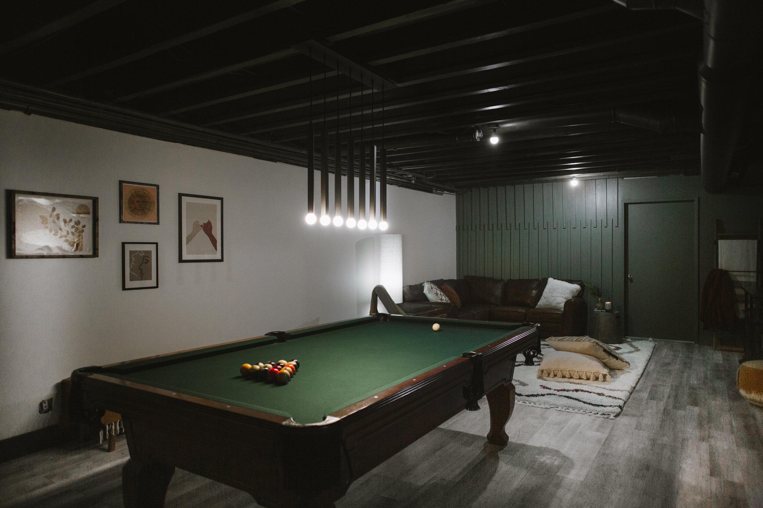 Exposed beam ceiling in basement painted Urbane Bronze