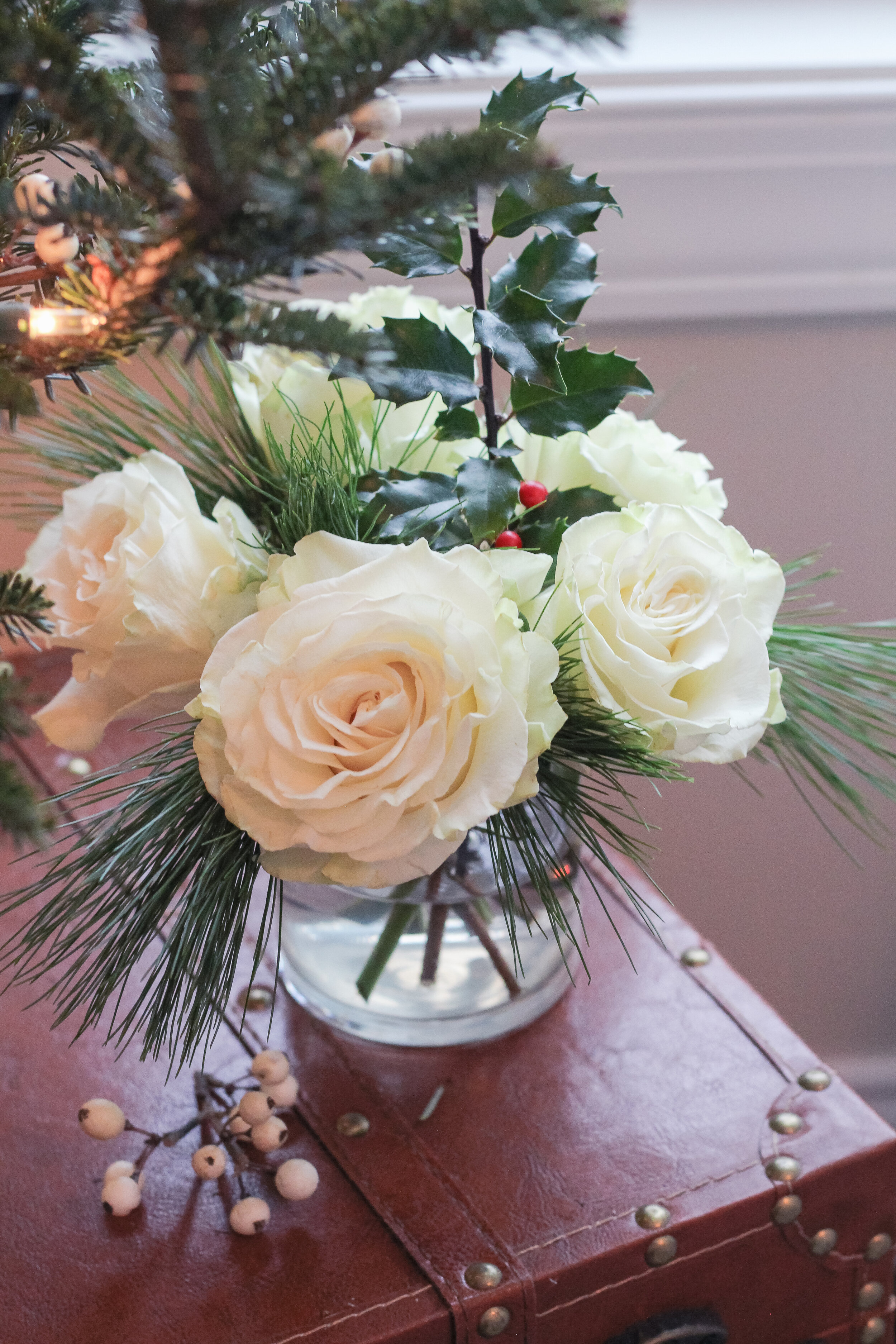 White Roses in Vase with holly and greens