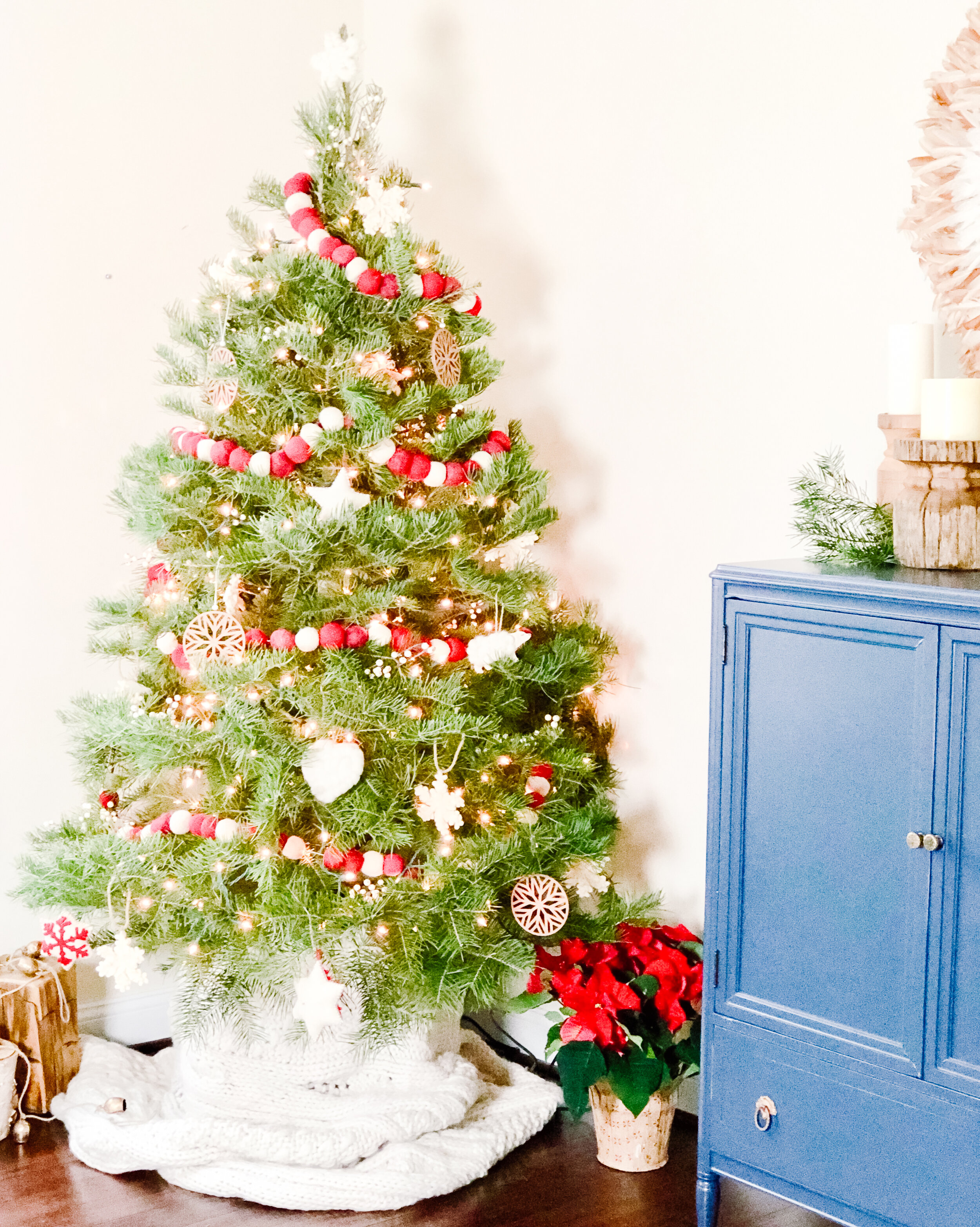 Fresh Tree with Red and White Pom Pom Garland