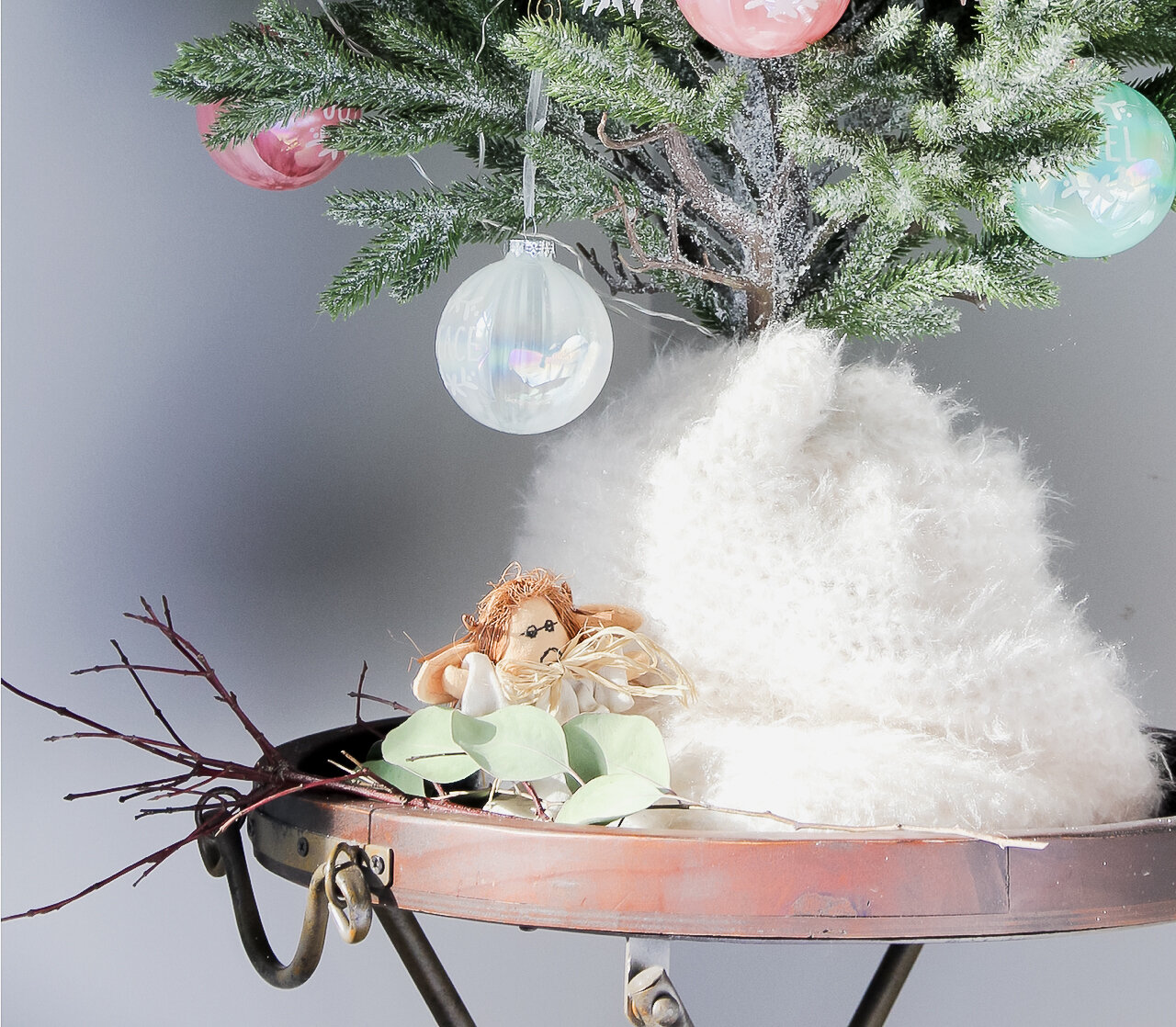 Scarf used as tree skirt for tabletop Christmas tree