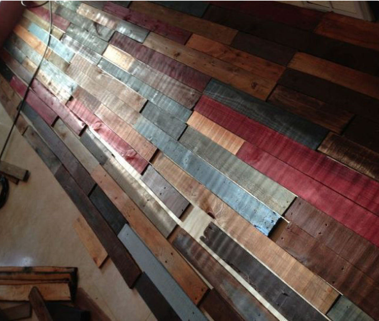 Mutli colored pallet wall in progress