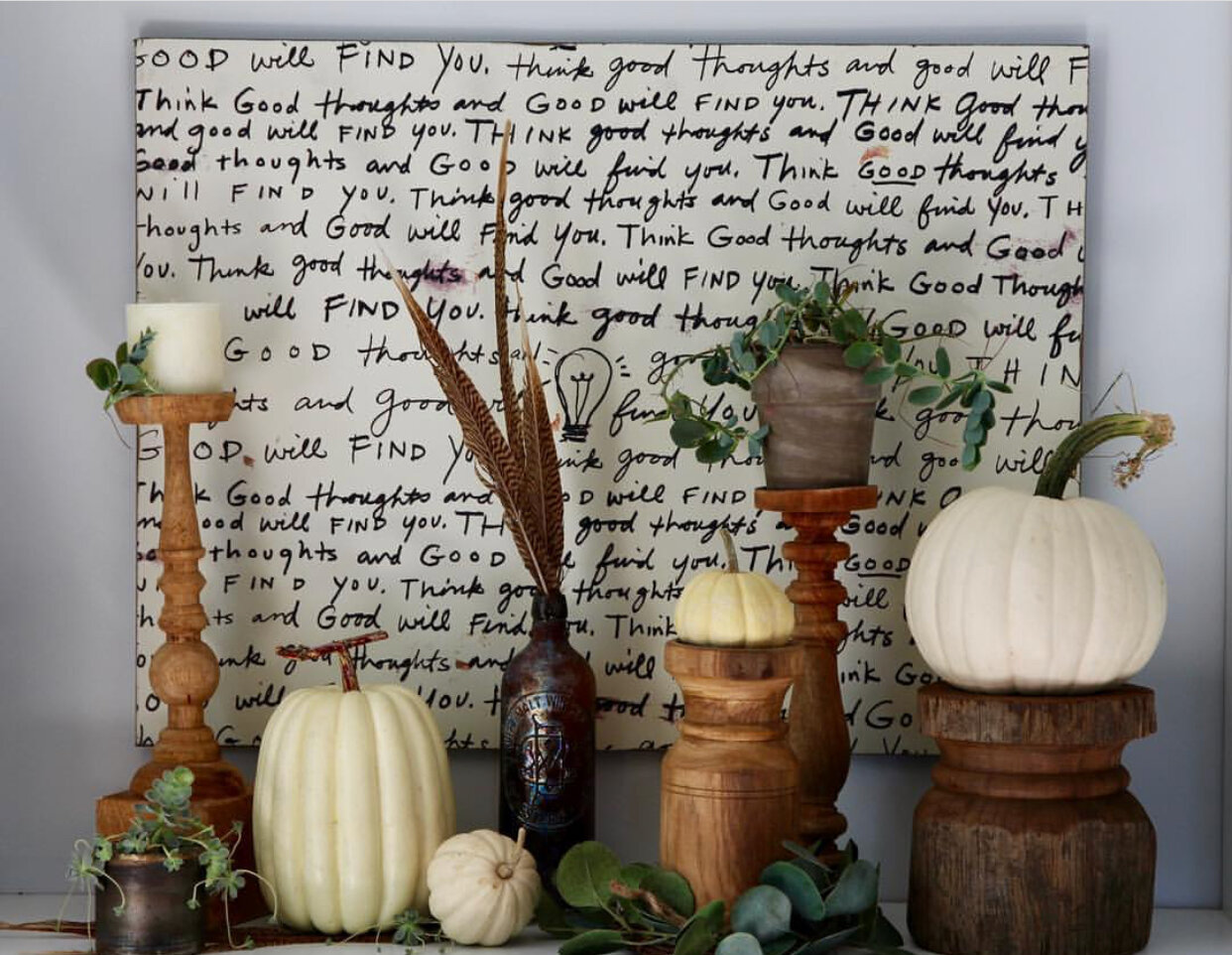 Art on bookcase with Fall decor