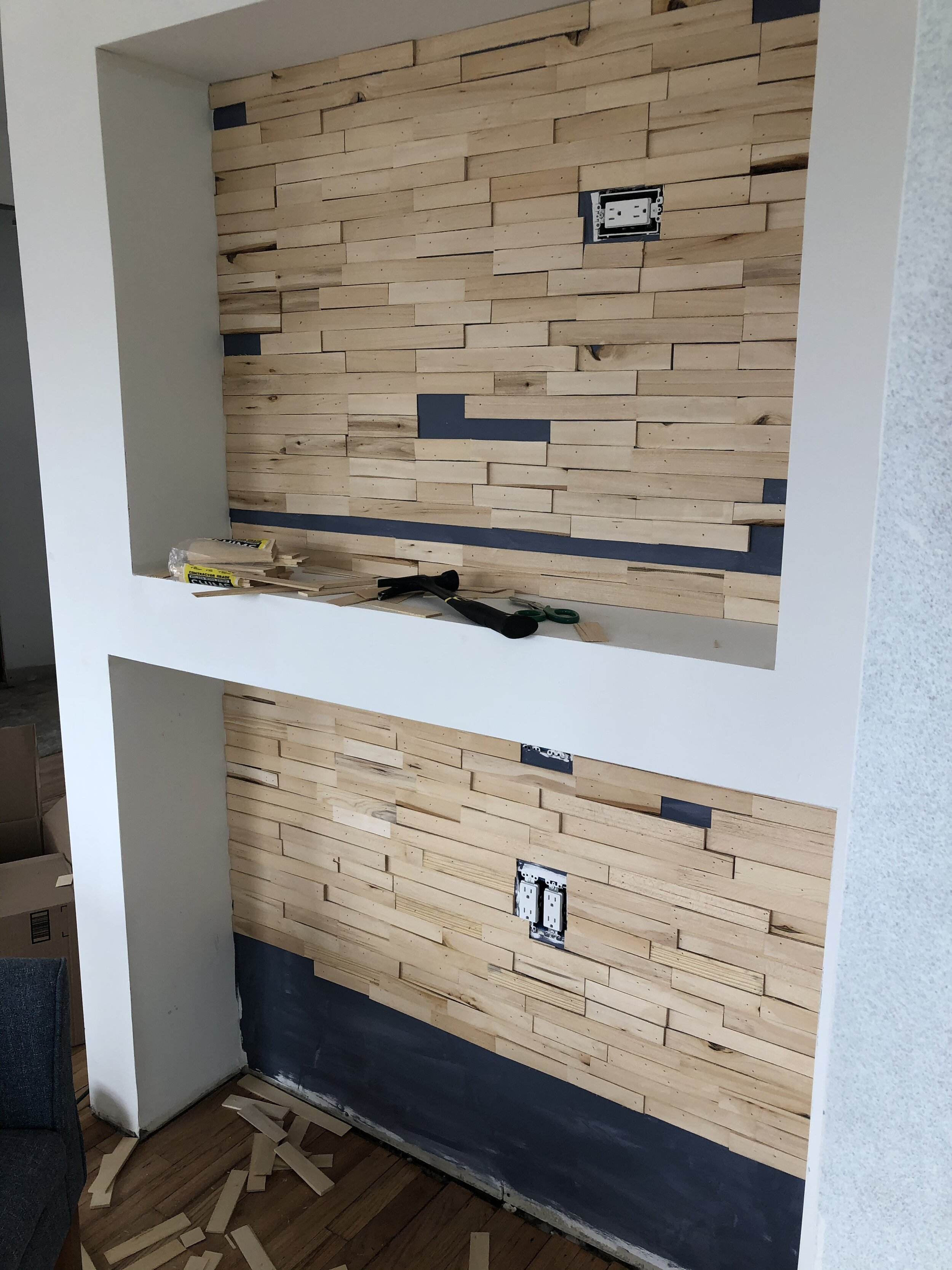 Installing wood shims on wall