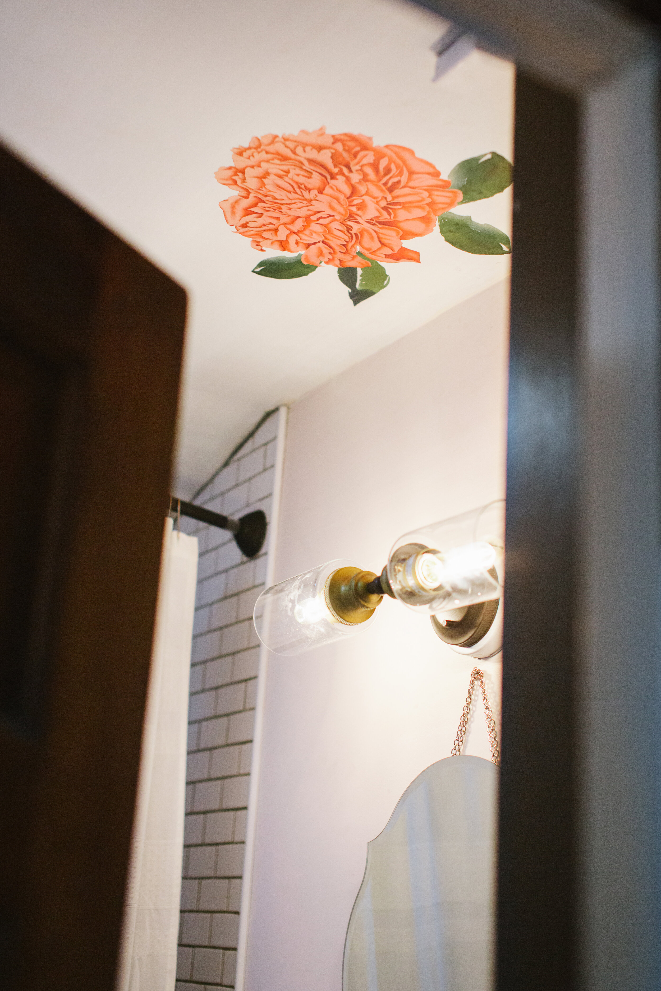 floral decals on ceiling in bathroom