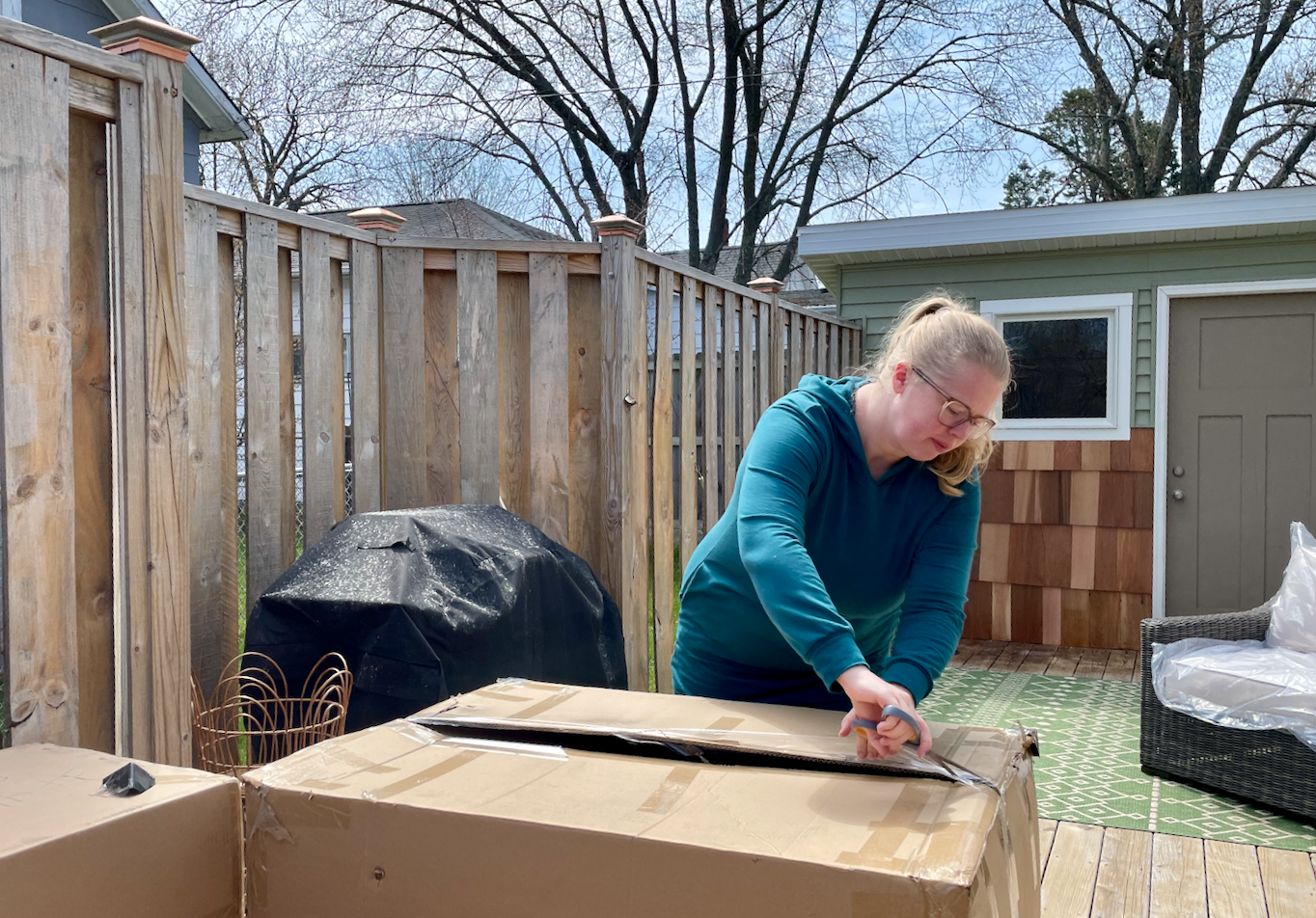Unpacking the Ajna Living Furniture delivery.