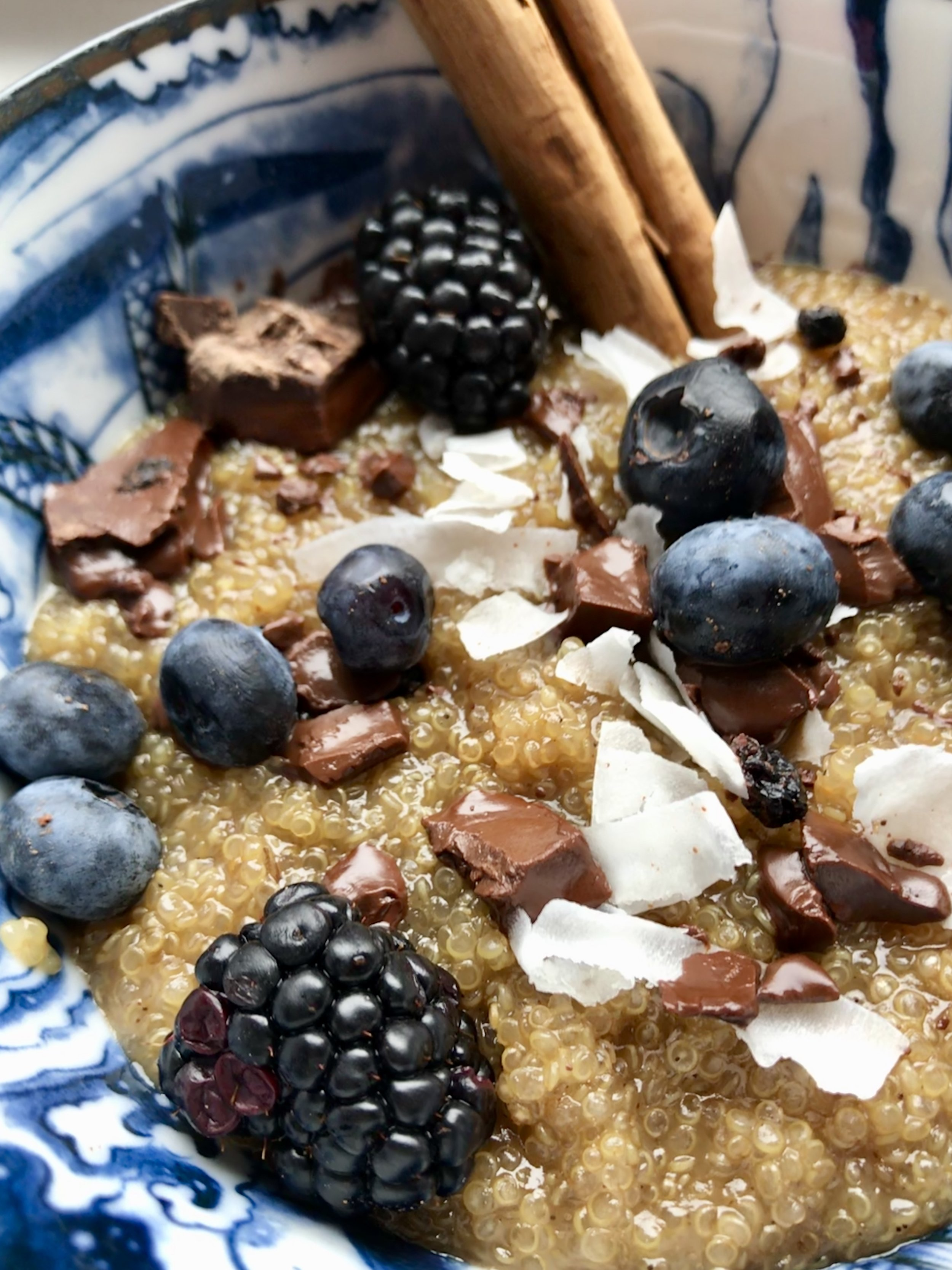 Warm Quinoa Pudding with Dark Chocolate and Berries