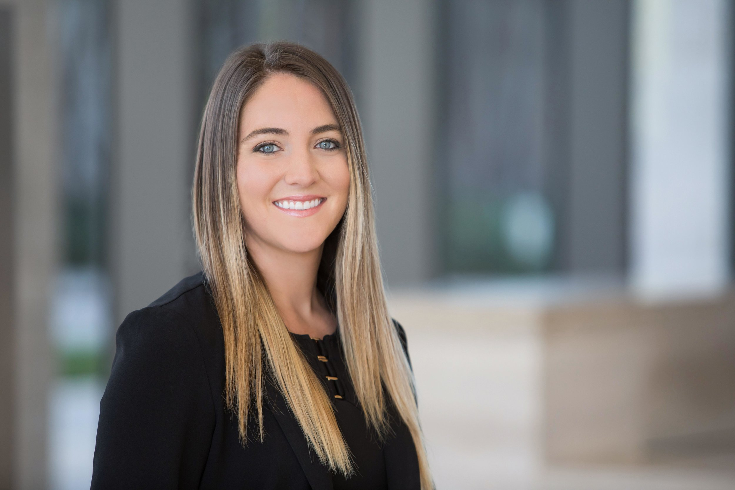 Professional corporate headshot and team photography for Merrill Lynch financial advisors women.
