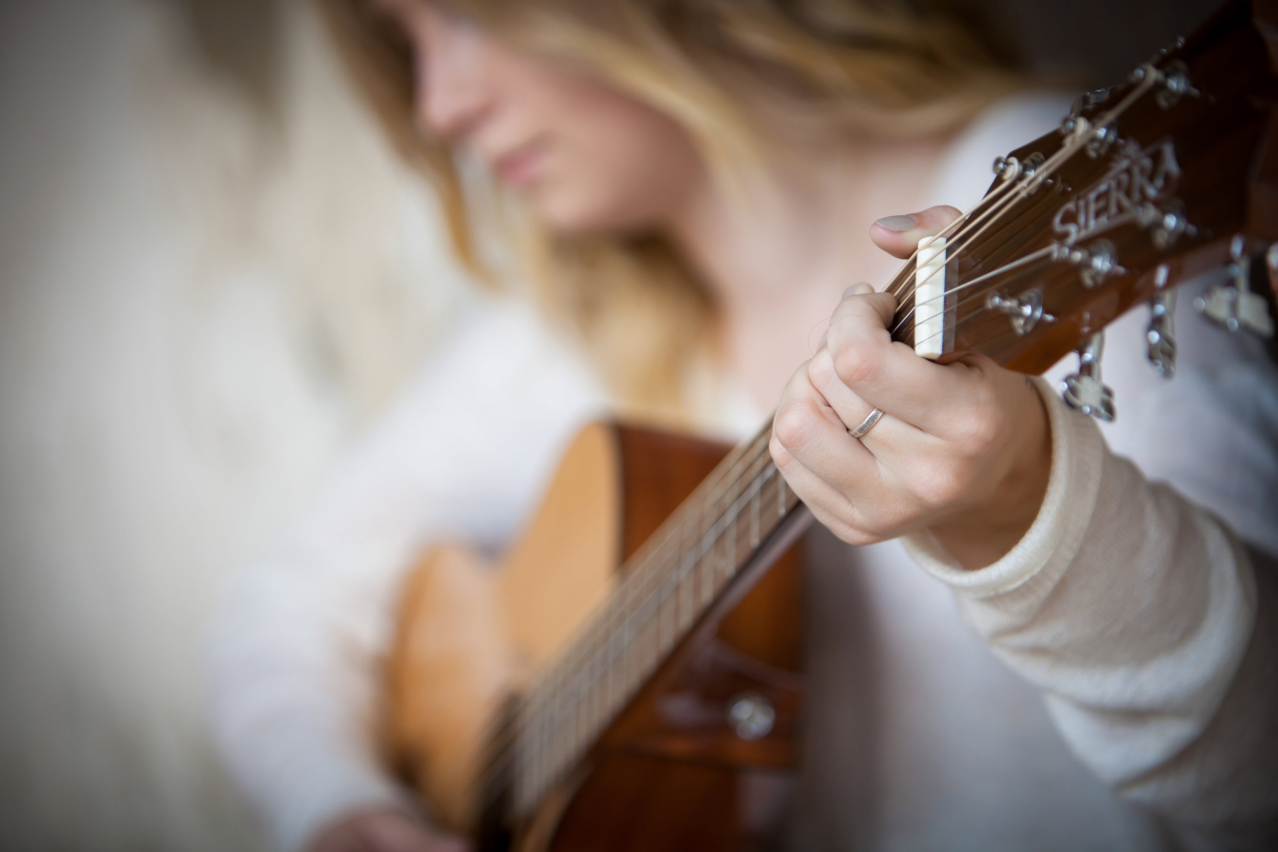 High school senior girl with her guitar
