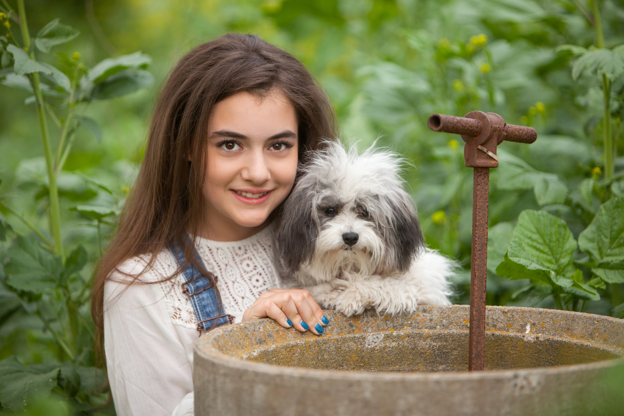 Pretty girl with long brown hair with her dog